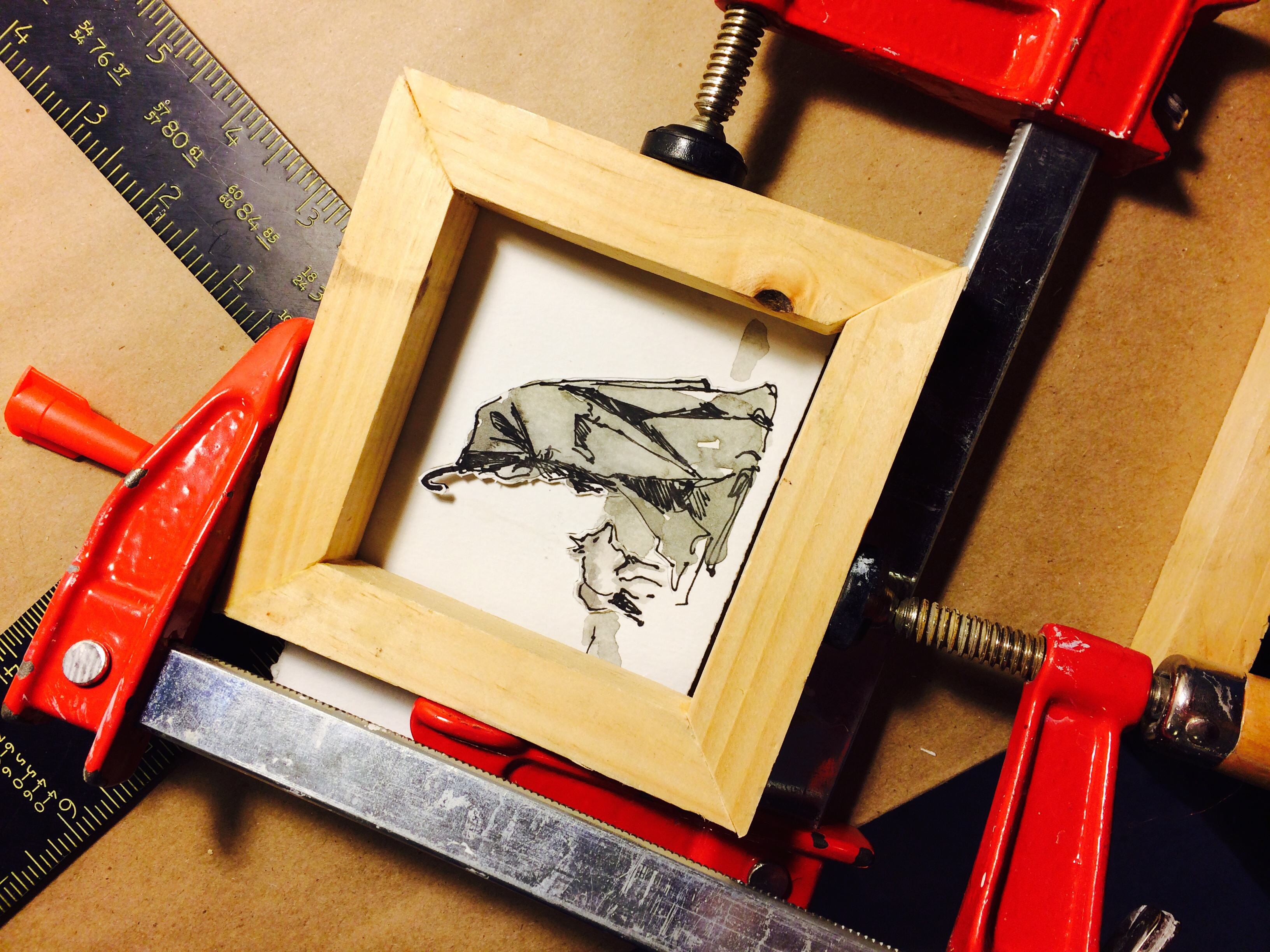 Little drawing of Joseph Beuys and coyote getting a handmade frame.