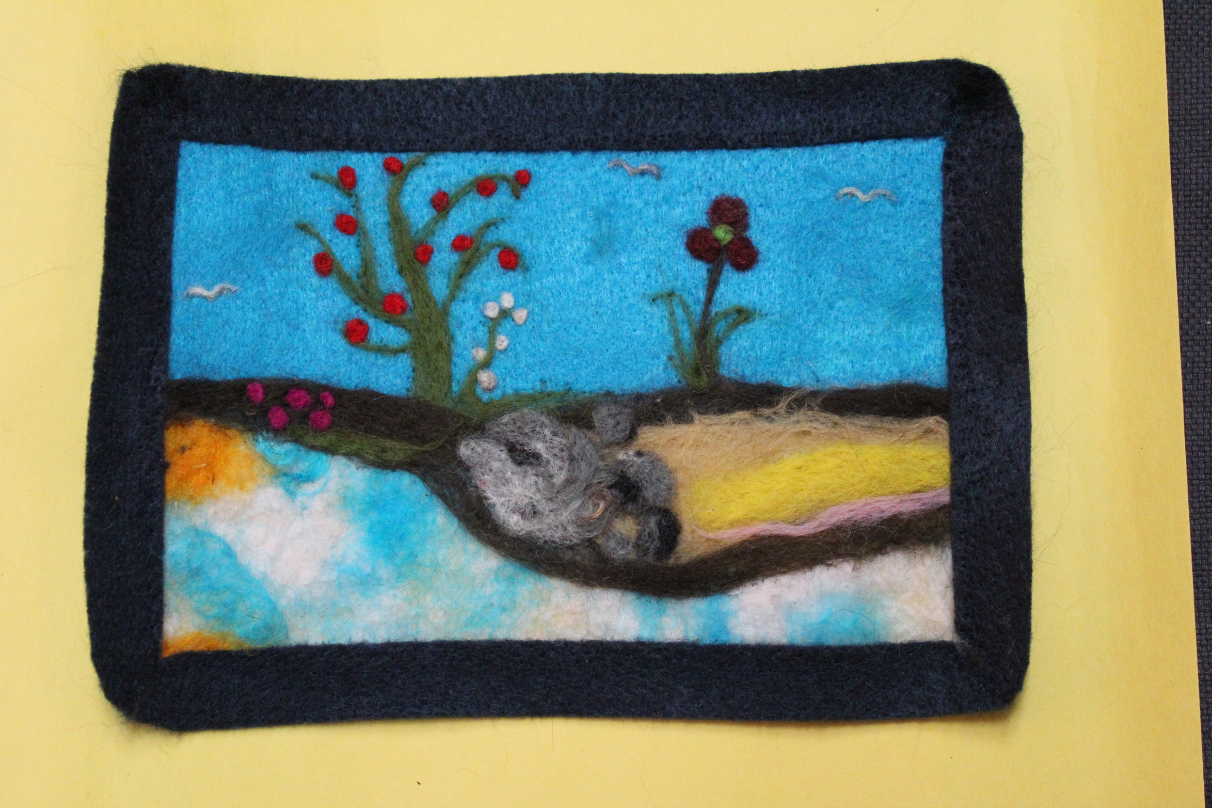 A first time needle felter's gorgeous landscape with frame.