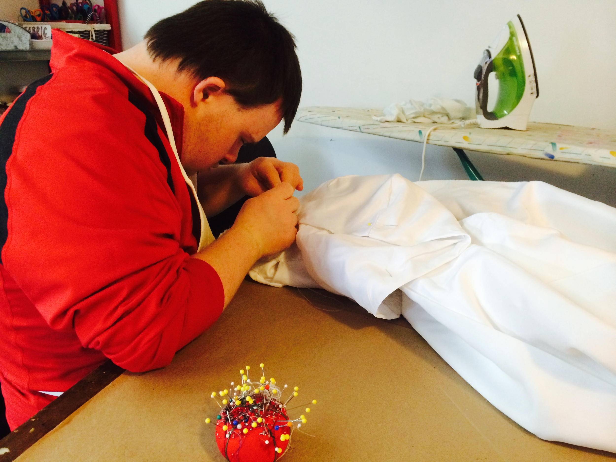 The incredible wedding dress/cape being sewn by hand again this week.