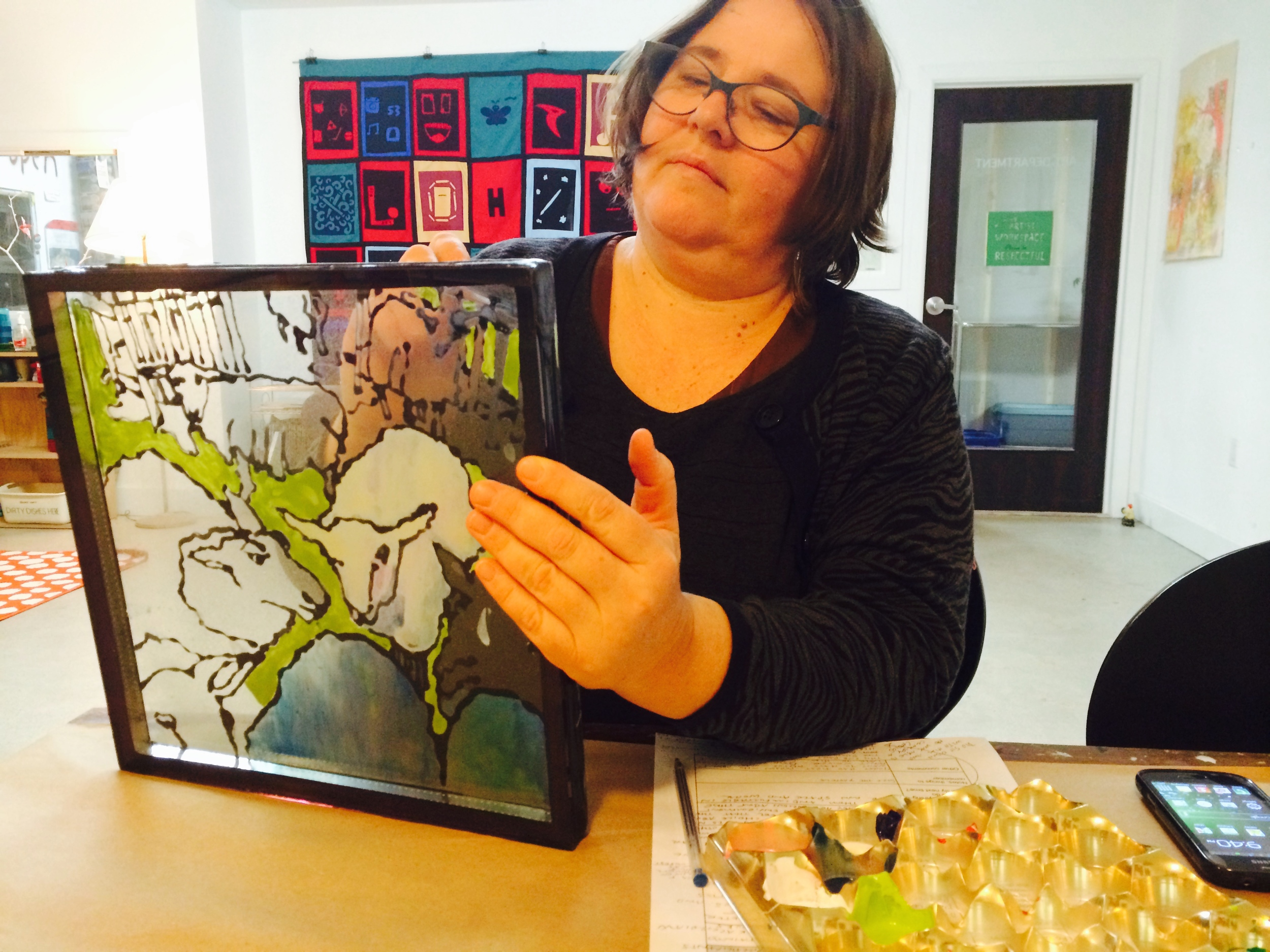 After cleaning up and rearranging the room, Heather works on her glass painting piece.  These little sheep are for one of our board members, who has a farm and many lambs to take care of starting at this time of year.