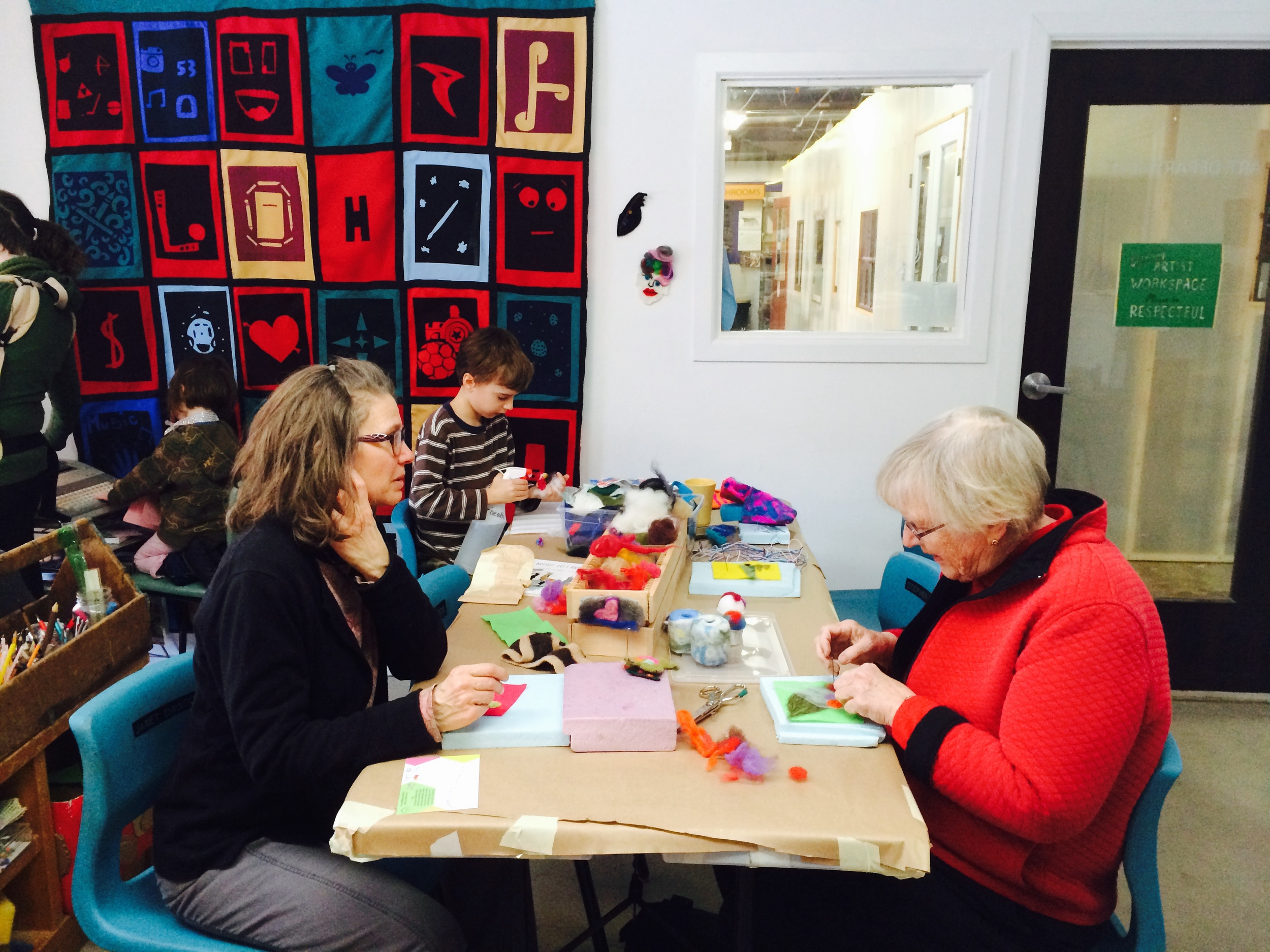 Needle felters and neighbours meeting for the first time. Sometimes the simple dialogue that surrounds an art technique allows people to feel at ease in a new space.