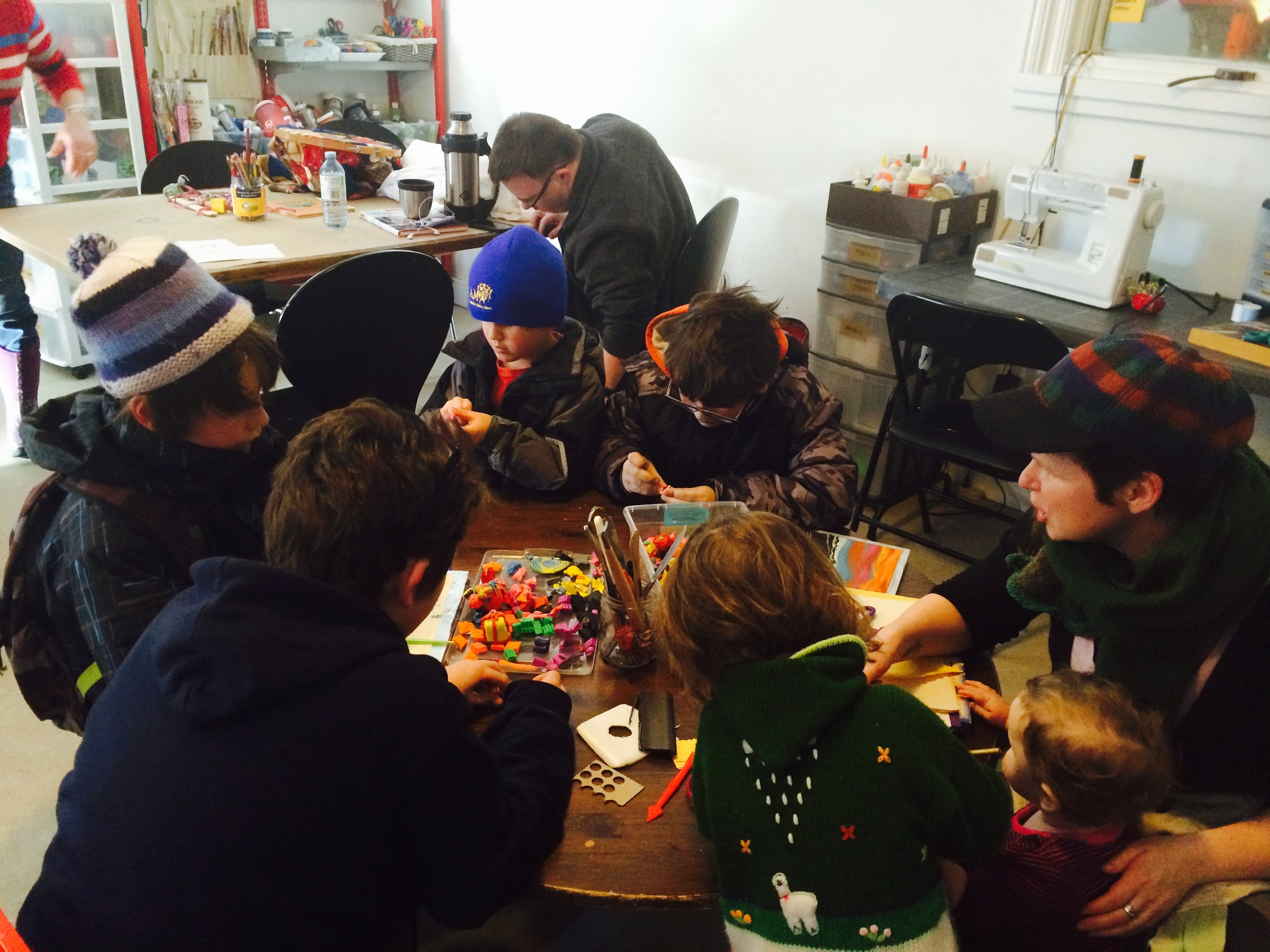 After school independent crowd mixed with preschoolers from the area - all busy at the kids' table with plasticine.