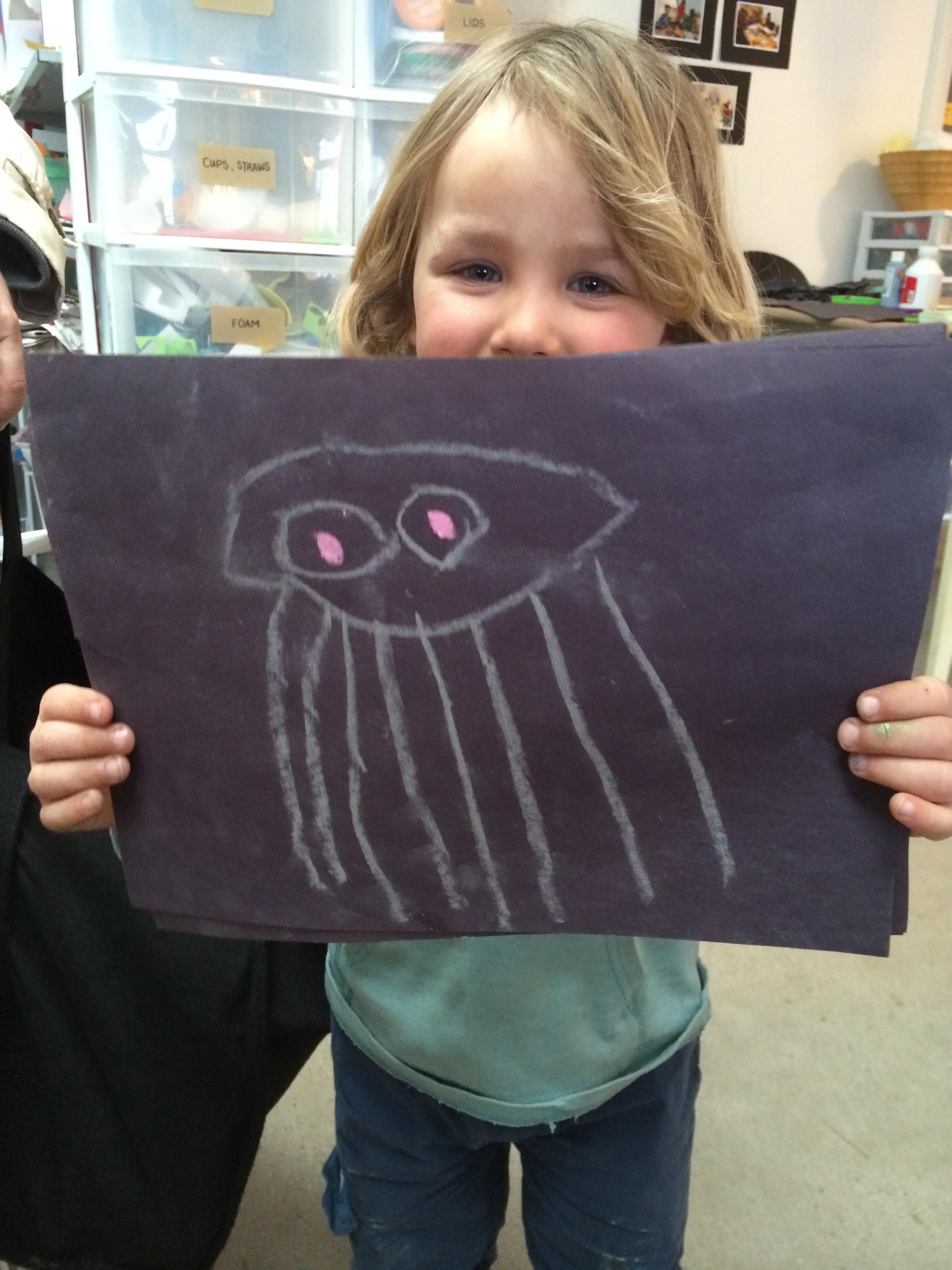 Jellyfish chalk drawing on black cardstock