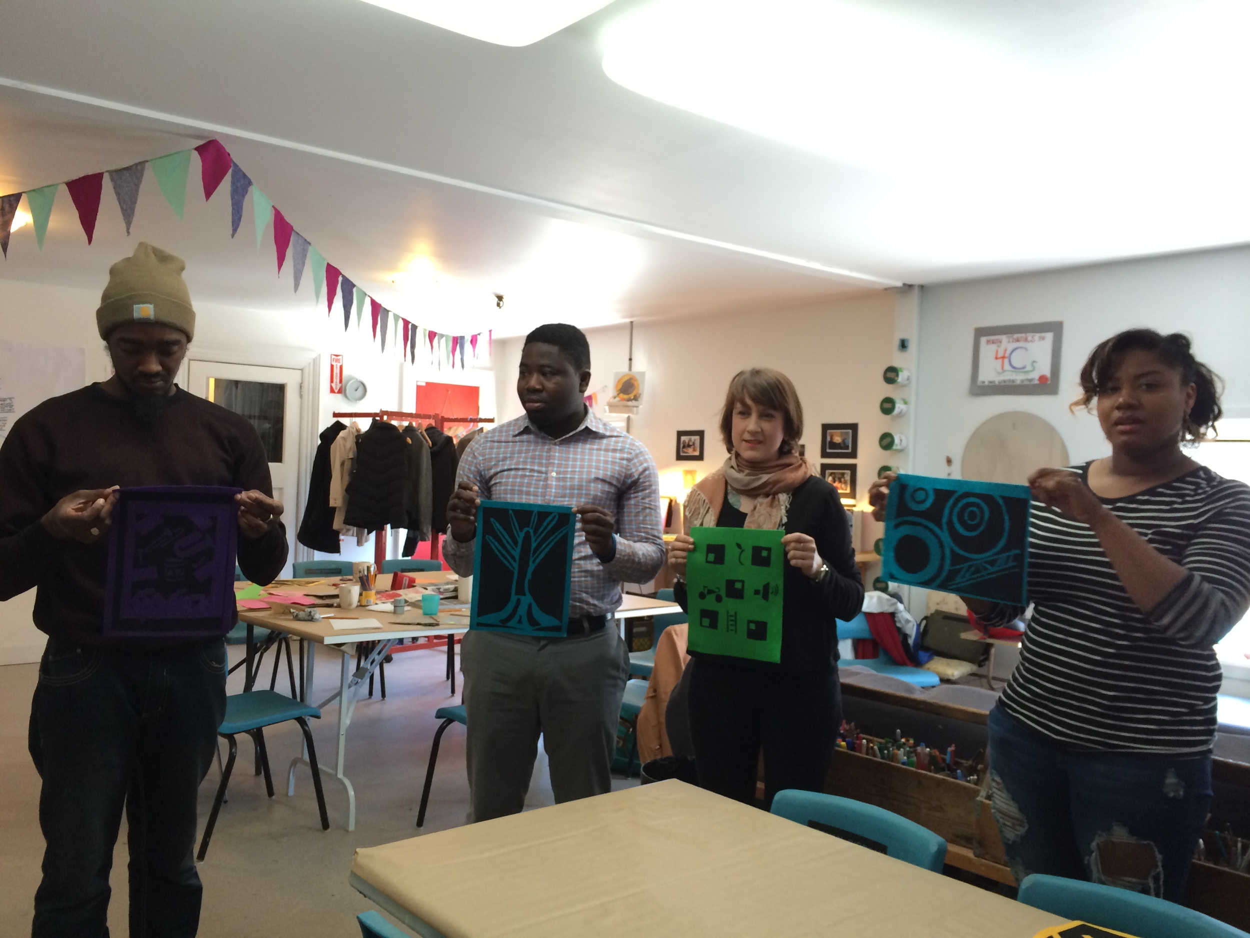 Northend Changemakers on site, trying out hand-cut stencil screen printing.