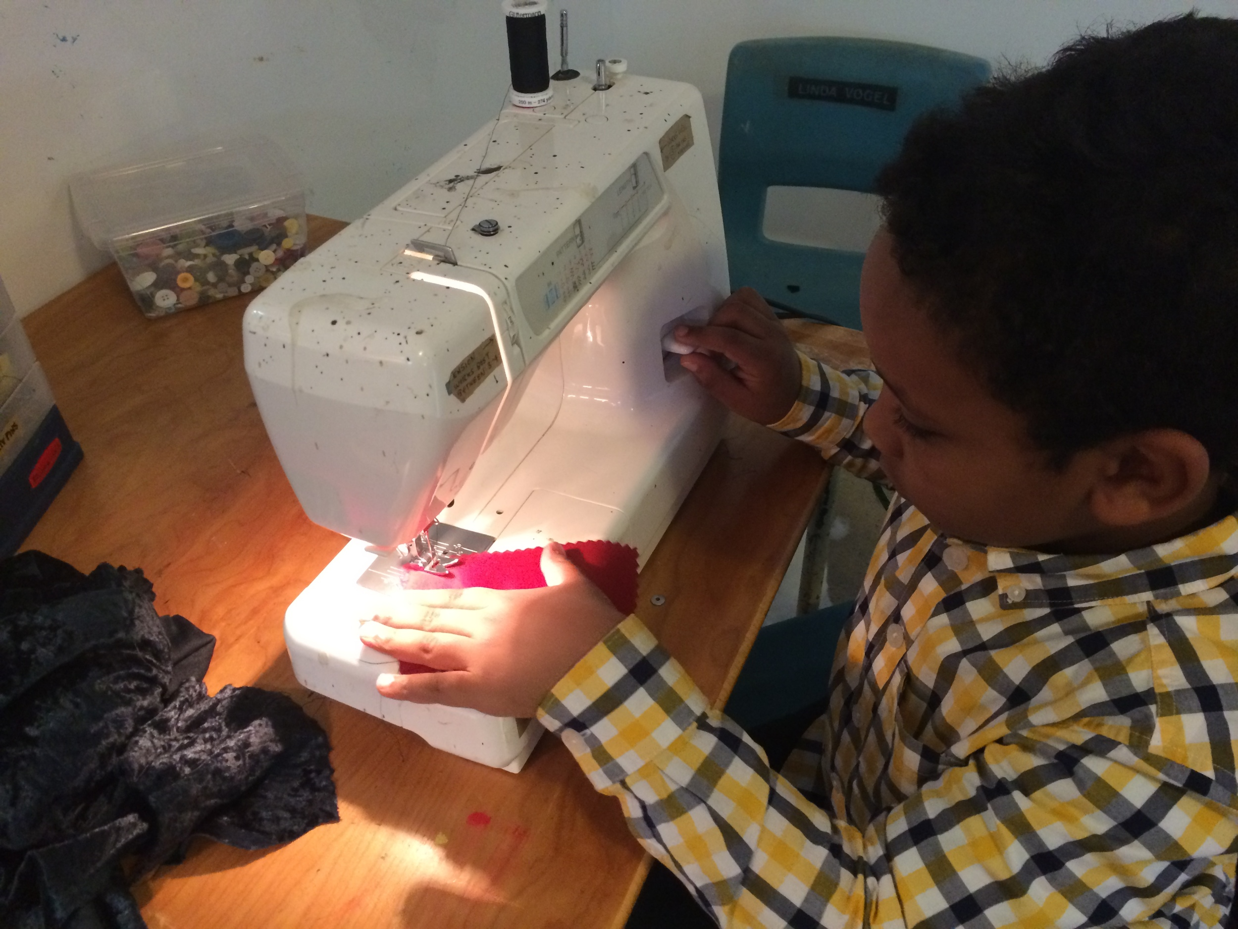 Introducing kids to the sewing machine is one of the highlights of working at the studio.