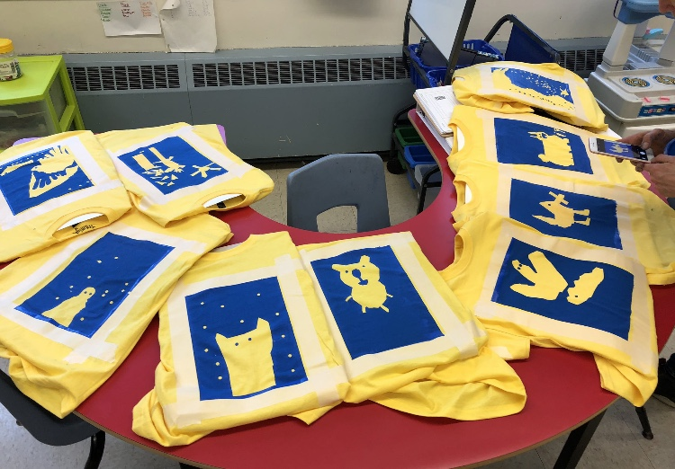 Shirts designed and silkscreened by Mme Swinamer's Grade 1 class at Ecole St Joseph's A McKay! We have an annual tradition of exploring geometric shapes to create unique t-shirt designs with all the grade 1 students at the school. And it's such a highlight to see kids around the neighbour hood in their distinctive school colours!  Photo credit: Mme Swinamer from Twitter @MmeSwinamer