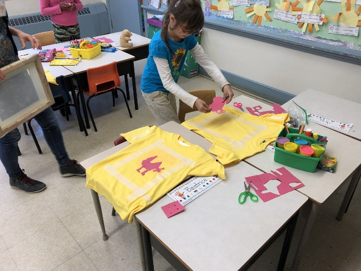 Learning about the paper stencil method of silkscreening!  Photo credit: Mme Swinamer from Twitter @MmeSwinamer