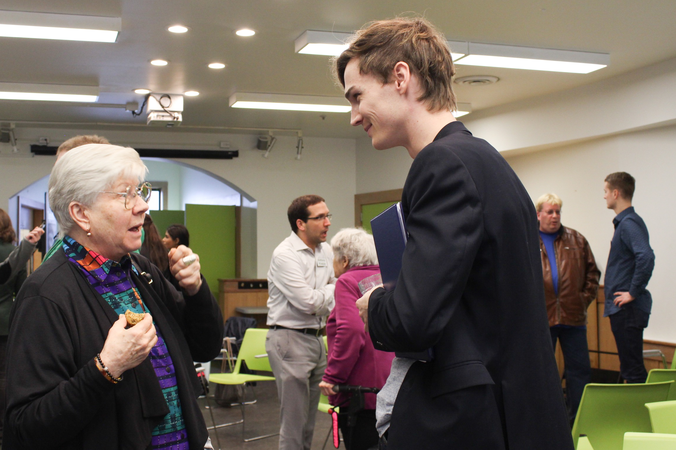 NDP candidate Spencer Chandra Herbert in discussion with a forum attendee.