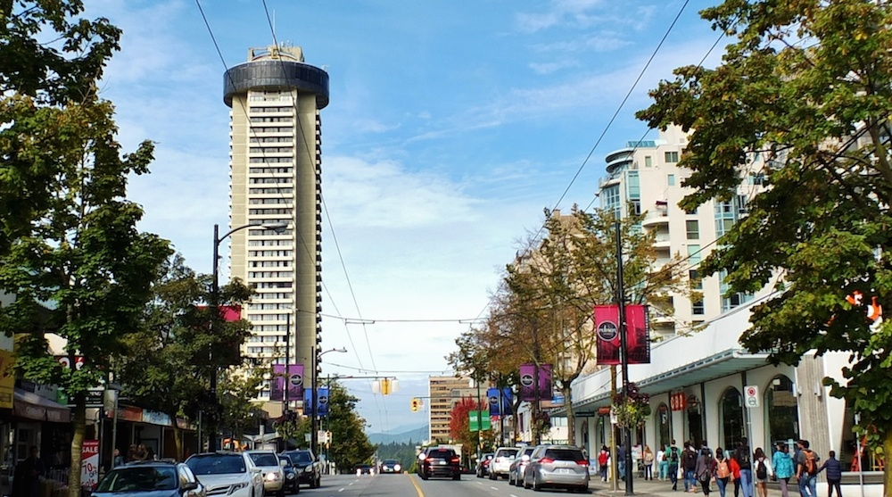 A recent photo of the Landmark towering over Robson Street.