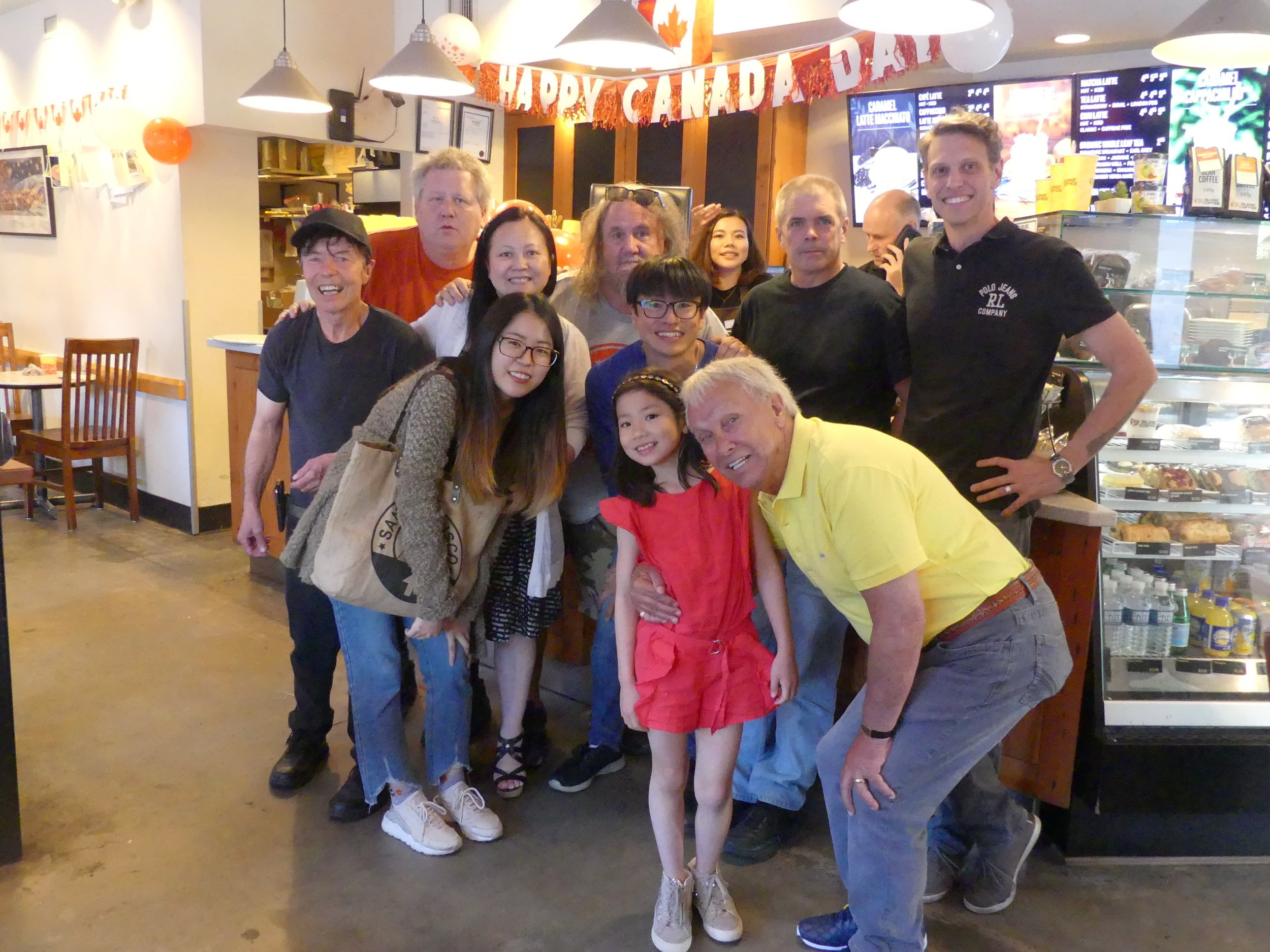 Blenz staff and regulars saying farewell to former owner Young Si (from left) back row: Ken Janco; James; Tina Si; Doug Batchelor; Nana Koike; Louis Bouchard; unidentified guy from head office; new franchise partner Michael Varesio; (front row) Rachel Kim; Erin Si; and an unidentified partier.