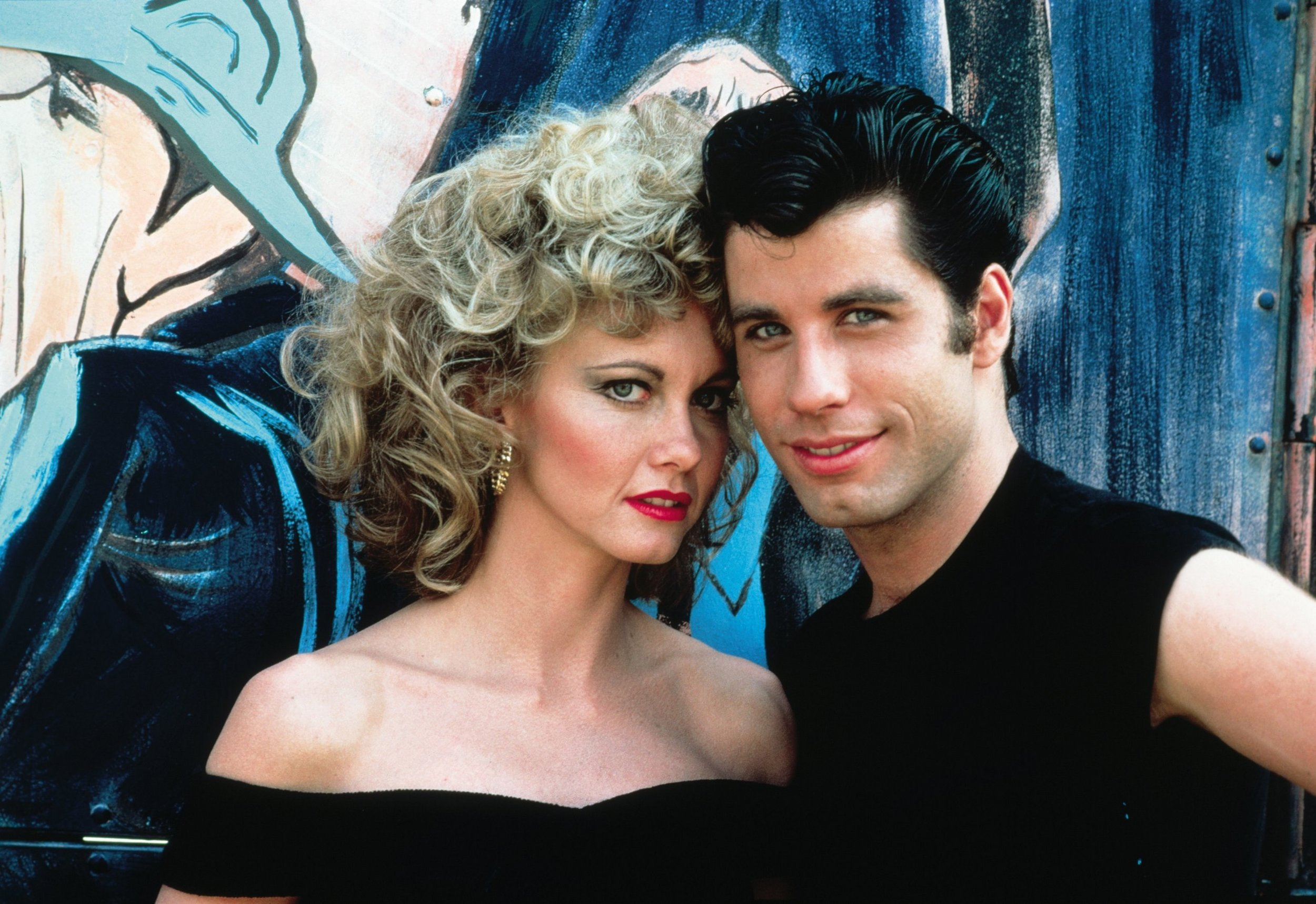 "John Travolta and Olivia Newton-John star in ""Grease"", playing in Stanley Park August 14."