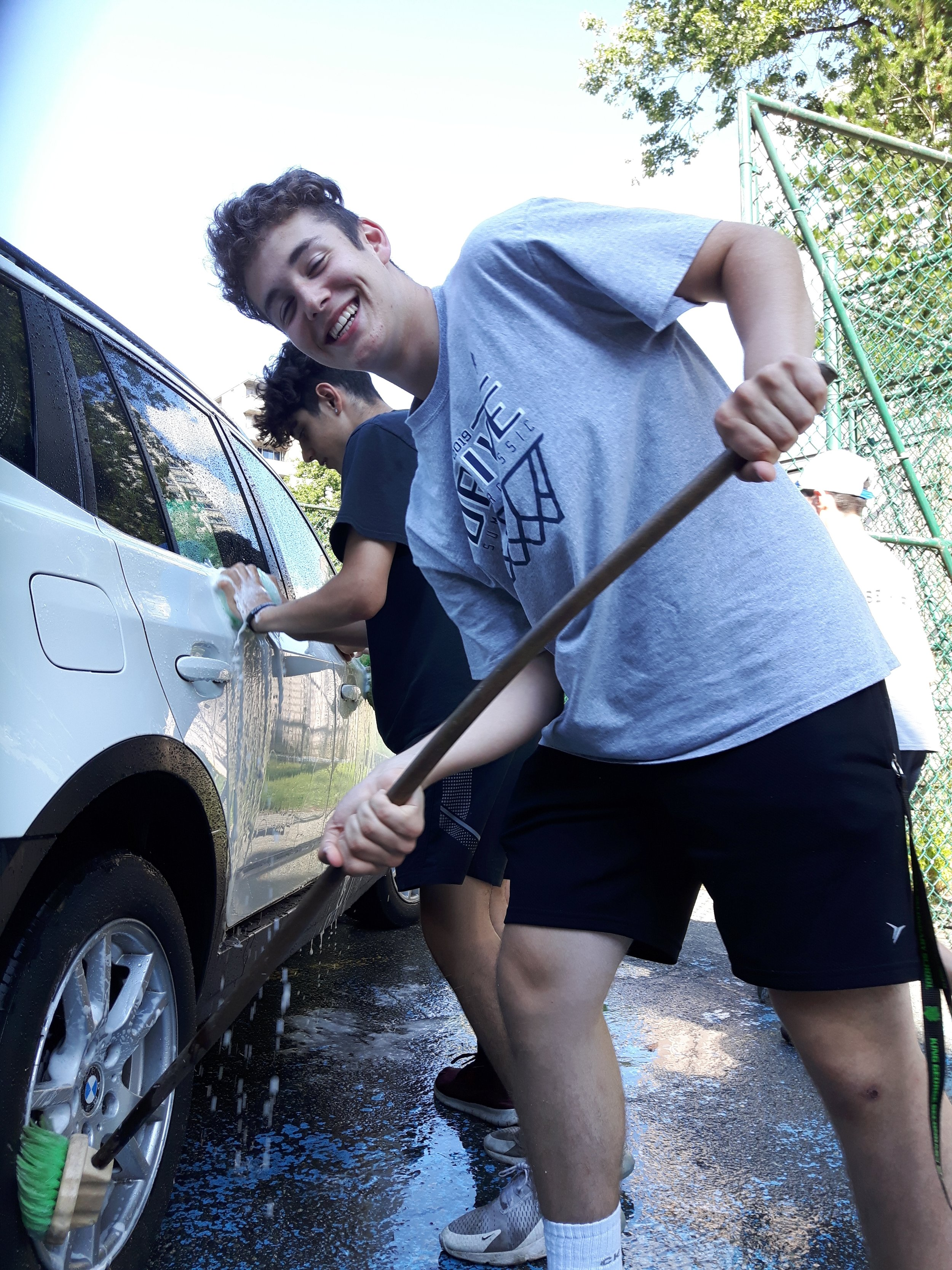 A firm but gentle scrub is what's needed, and the King George Dragons' car wash team is up to the chore.