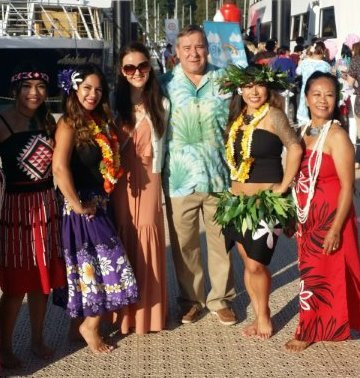 Randy Vannatter, president and CEO of City Passports, with a bevy of Hawaiian-themed attendees, boarding the Clefs d'Or charity boat cruise.