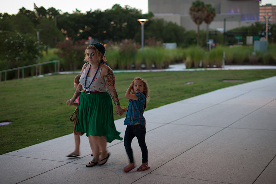 Mom walking with kids in downtown Tampa, Florida. © Jeremy Allen