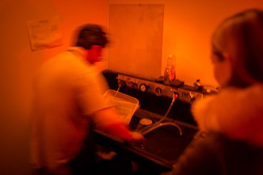 Joseph Gamble and Katie in the tintype darkroom.