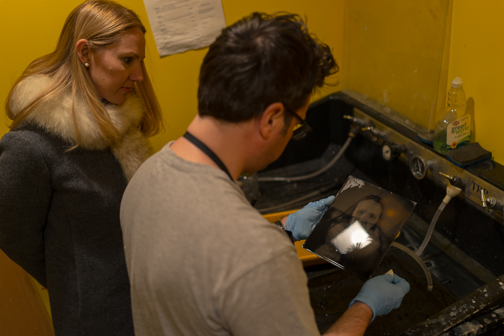 Joseph Gamble and Katie inspect the 8x10 tintype portrait (Sony RX1, iso 500, 1/40, f2).