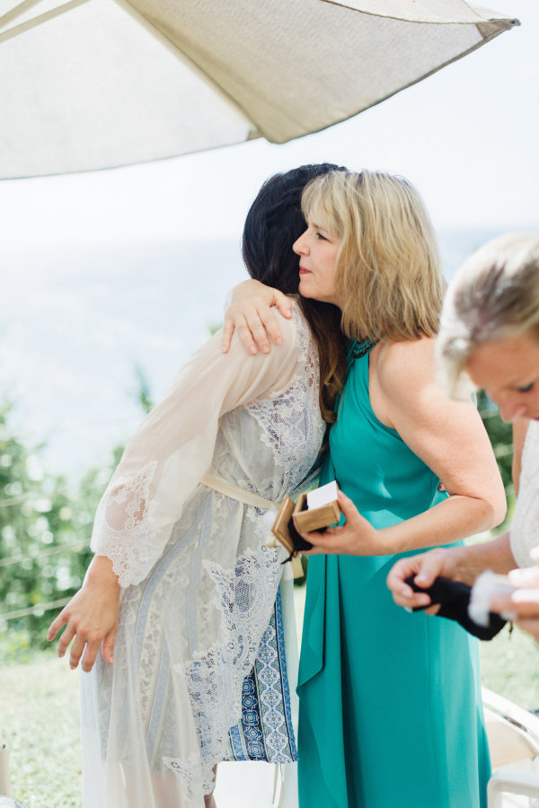 Bobby and Karena's moms each received a Coordinates Pendant - and Karena even kept one for herself!  Jana Williams Photography |  Style Me Pretty