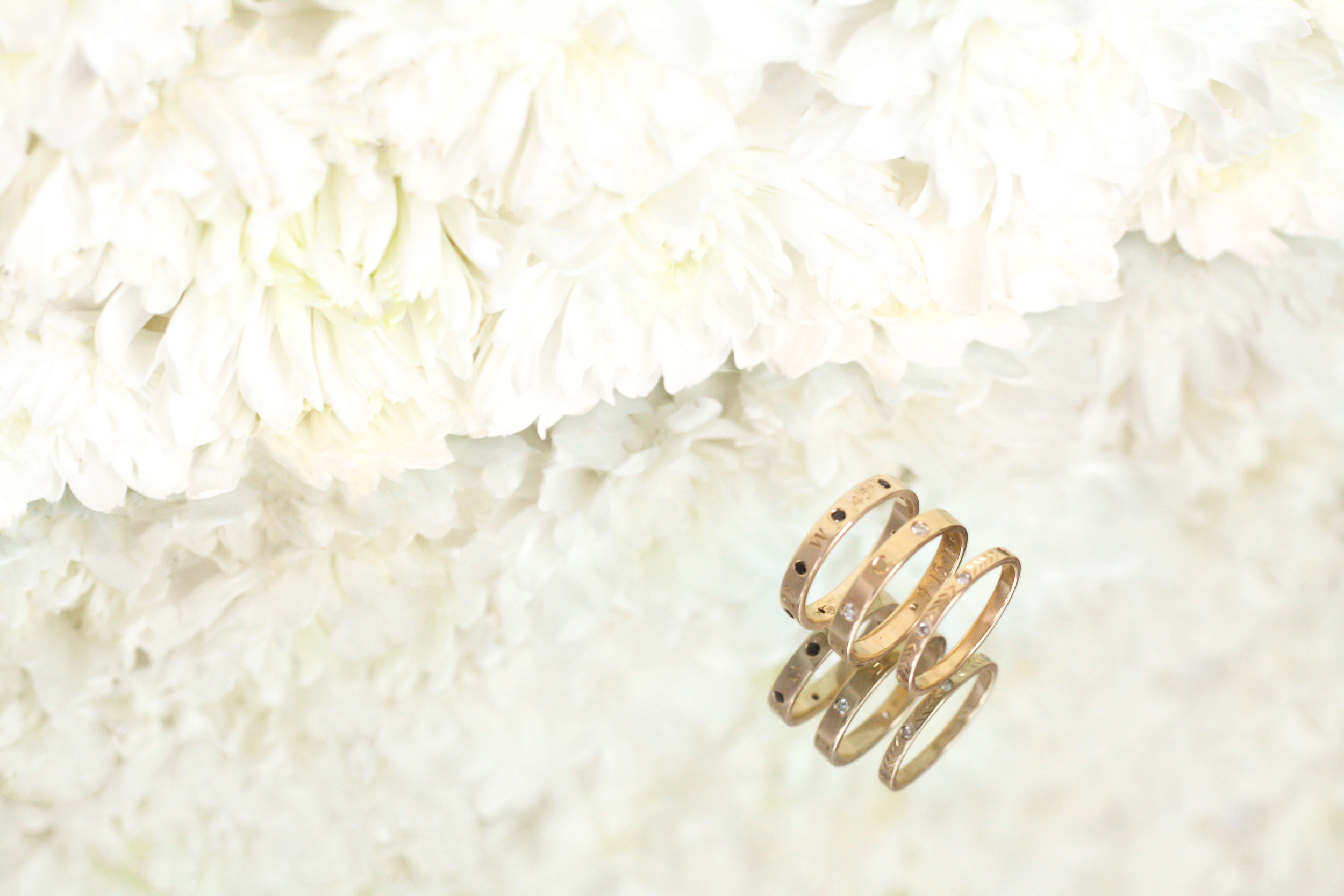 custom-rings-by-kerry-gilligan-coordinates-ring-staker-ring-and-namesake-ring.jpg