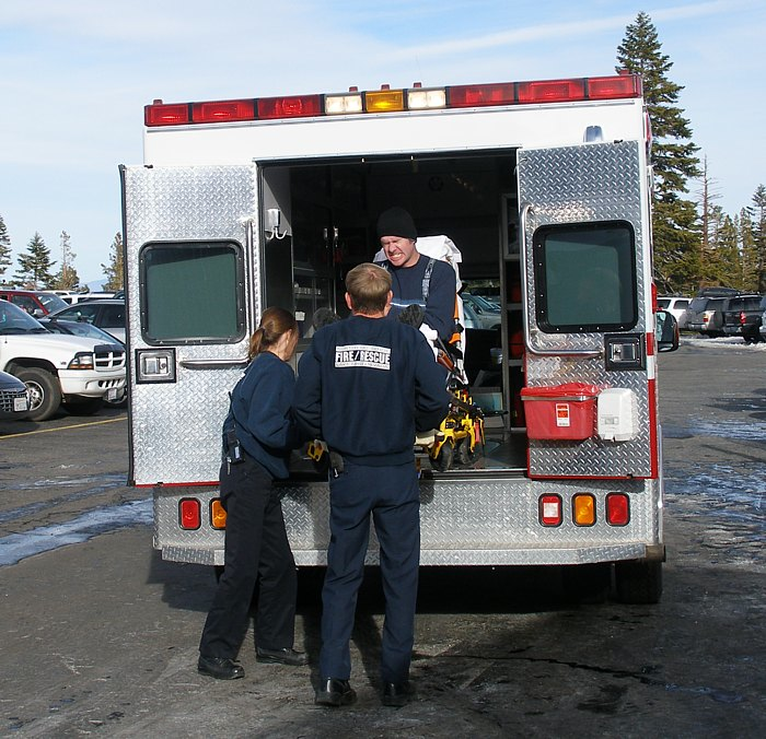 http://upload.wikimedia.org/wikipedia/commons/f/f4/EMTs_loading_a_patient.jpg