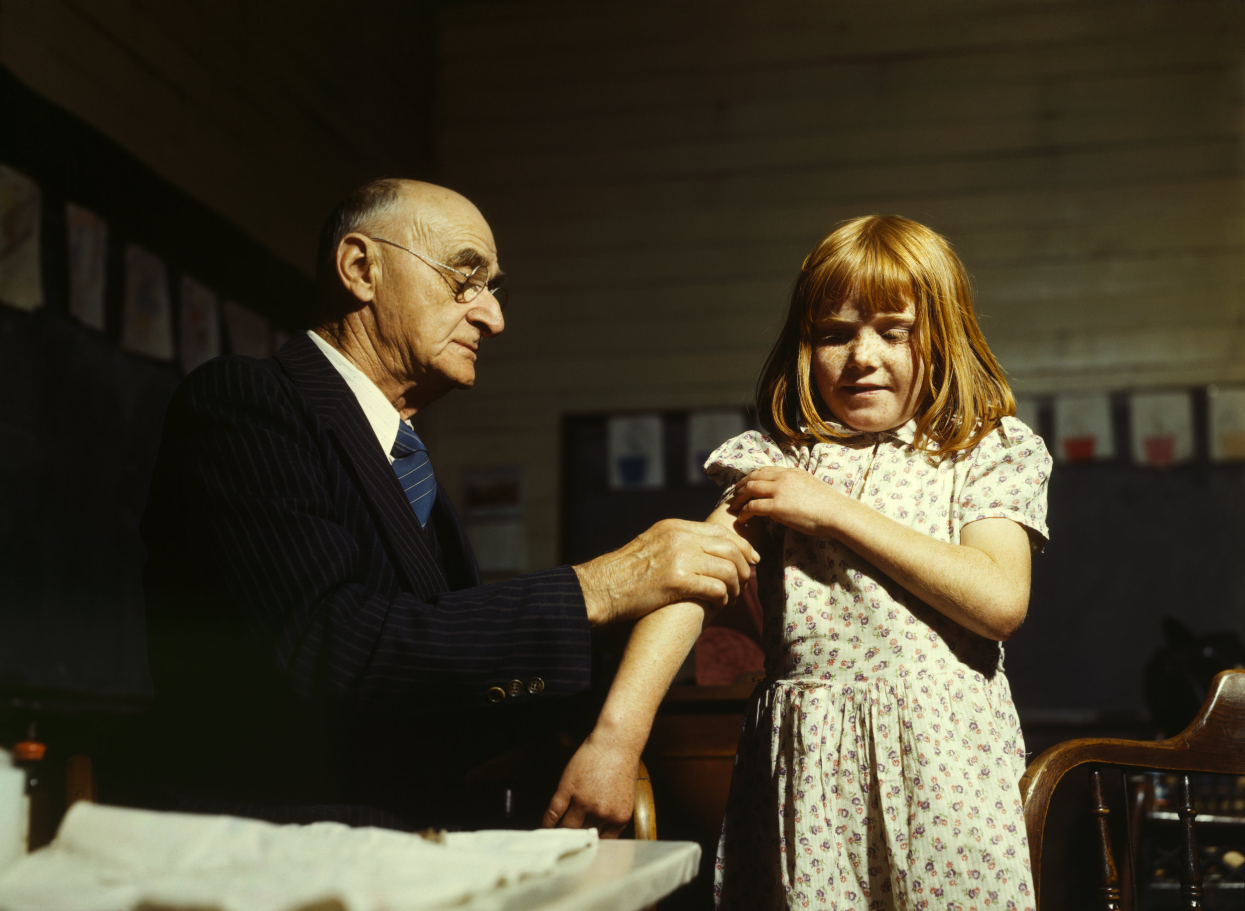 A child receives a typhoid vaccination https://upload.wikimedia.org/wikipedia/commons/b/be/Typhoid_inoculation2.jpg