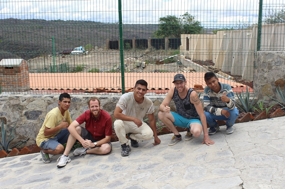 Three of our youth working hard in the construction, with directors Justin and Darren.