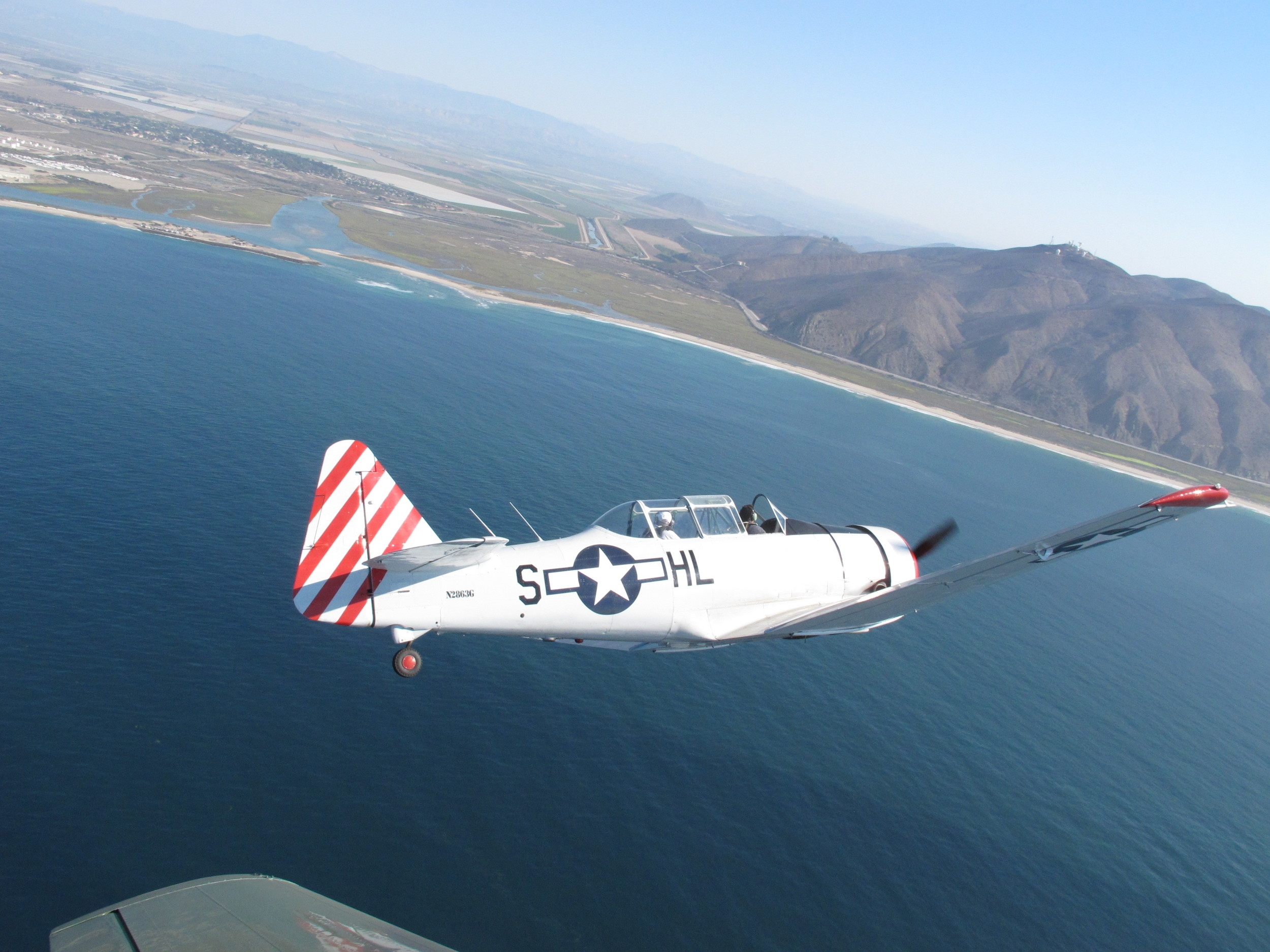 The Condors approaching for a flyover during the ceremony at NBVC - Pt. Mugu