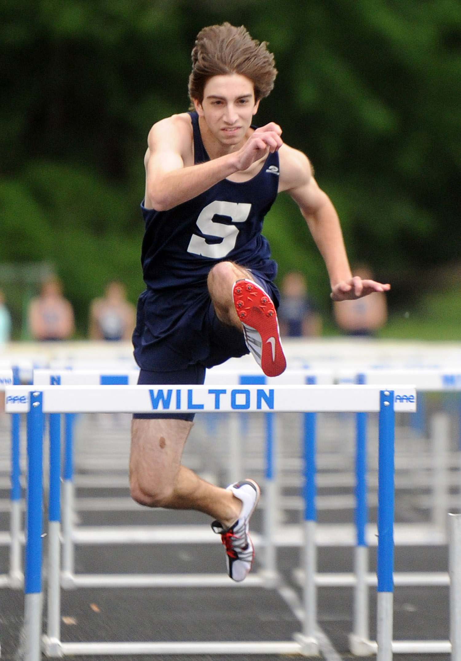 Todd Lubin jumps a hurdle during a track meet at Wilton High School on May 19, 2011.
