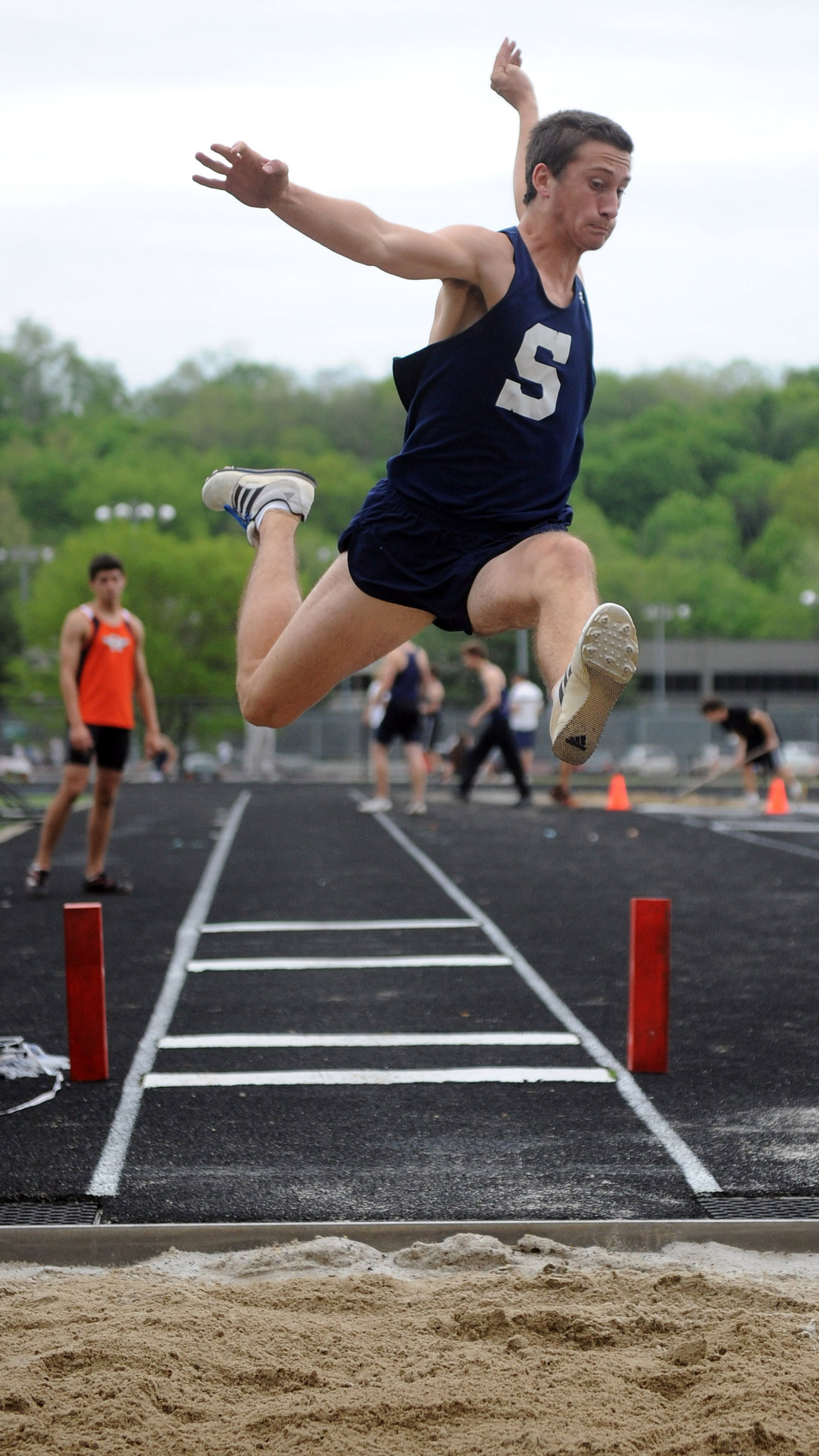 Dan Marriott competes in the long jump during a track meet at Wilton High School on May 19, 2011.