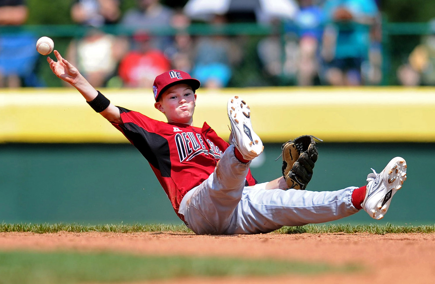 Billy McGrath throws to first after diving for a ball during Fairfield American's first game of the Little League World Series in Williamsport, Penn., on Friday, August 20, 2010.