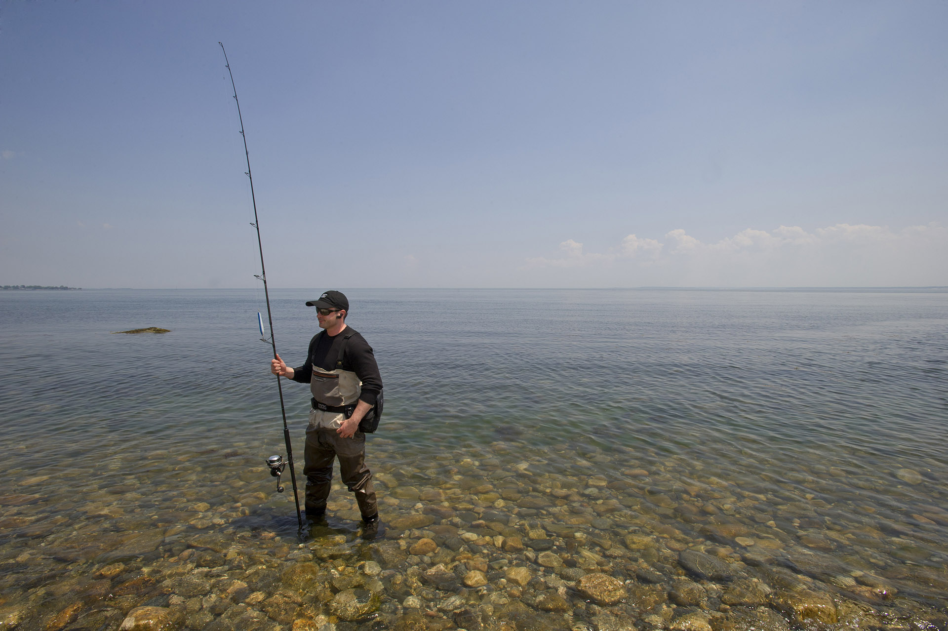 Gregory McNamara fishes in the water of the Long Island Sound at Shippan Point in Stamford, Conn., on Thursday, May 30, 2013.
