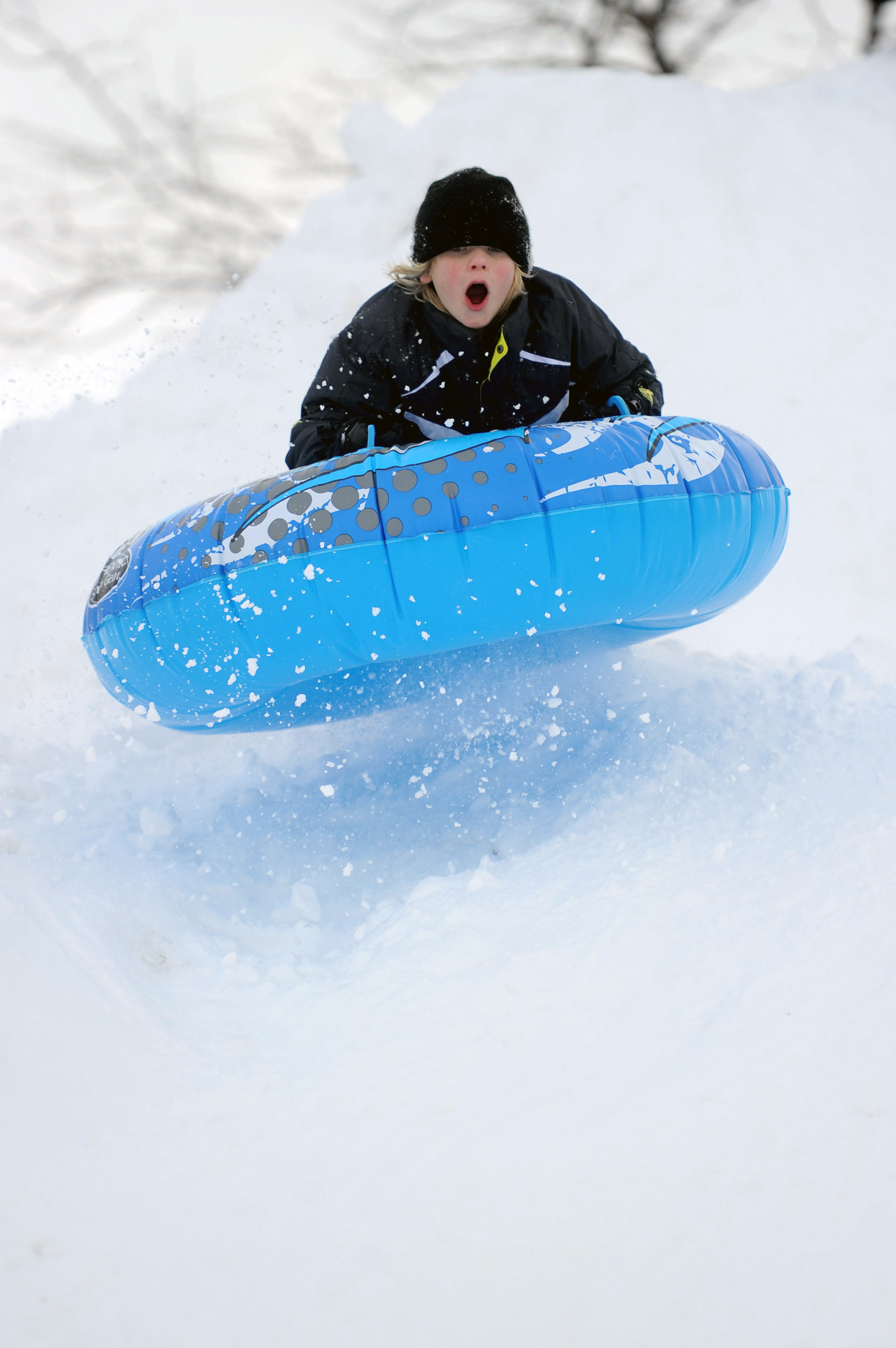 Christopher Puchala, 11, catches some air as he sleds off a giant mound of snow created by plows in Westport on Wednesday, January 12, 2011.