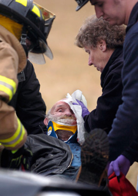 Arthur Ison is moved onto a stretcher after a car accident on South Bridge St. near U.S. 23 caused his head injury.