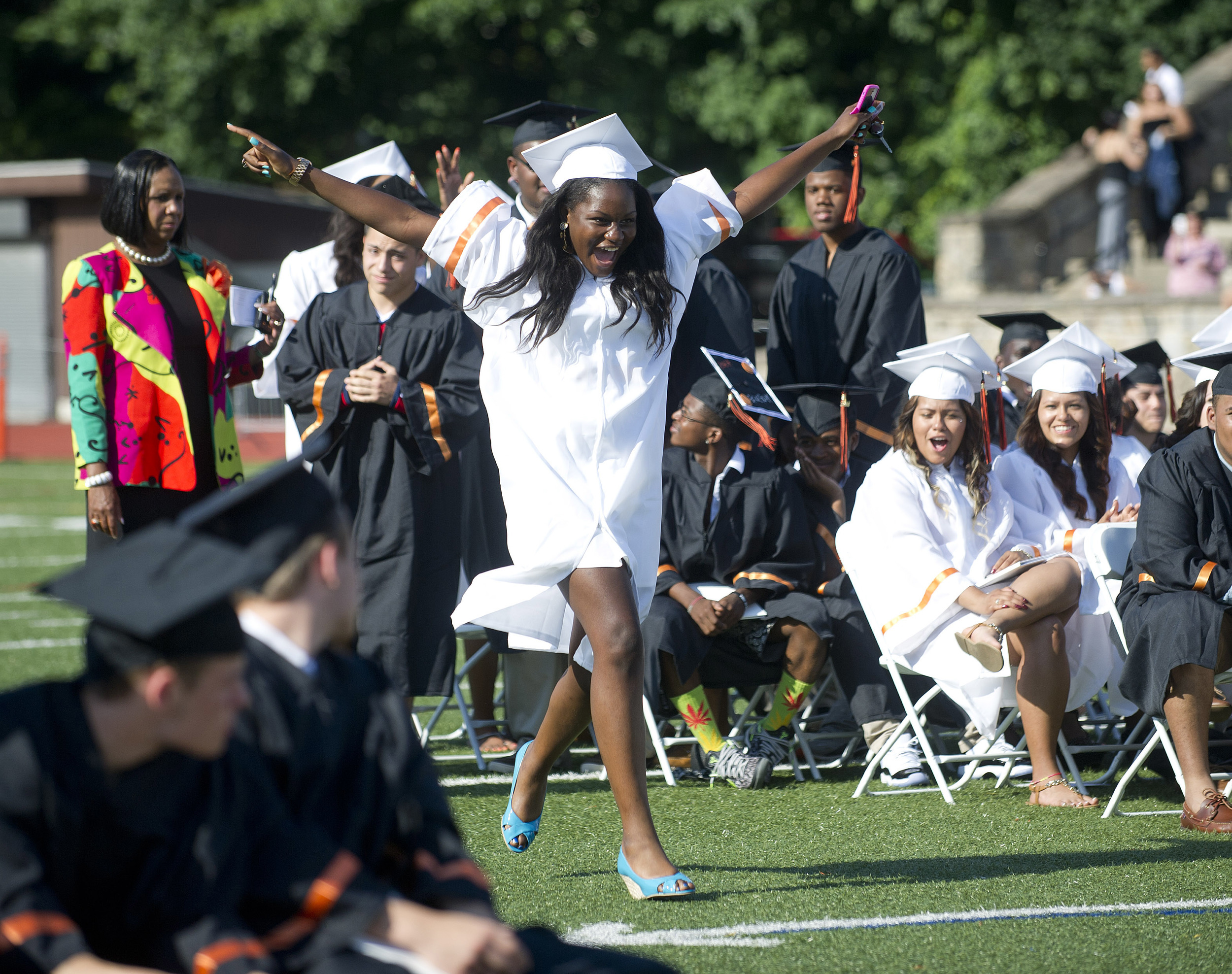 Stetya Jean Baptiste dances her way to the podium to get her diploma during the Stamford High School commencement ceremony on Thursday, June 19, 2014.