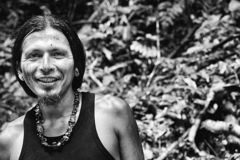 Juan Carlos smiles at a waterfall in the jungle
