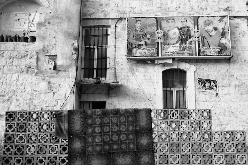 """Posters of """"martyrs,"""" those killed in the occupation, hang on the buildings in Nablus"""