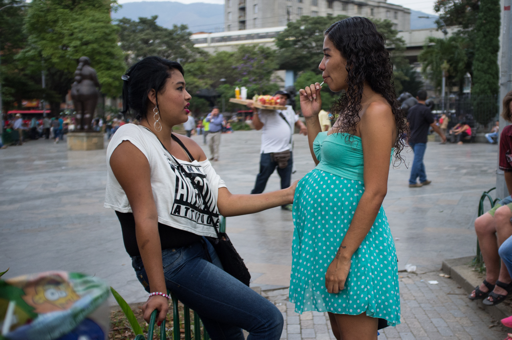 Two girls, one of them pregnant, spend an afternoon with friends in the city center of Medellín. Pregnant or baby-toting teenagers is a common sight in the busy metropolis.