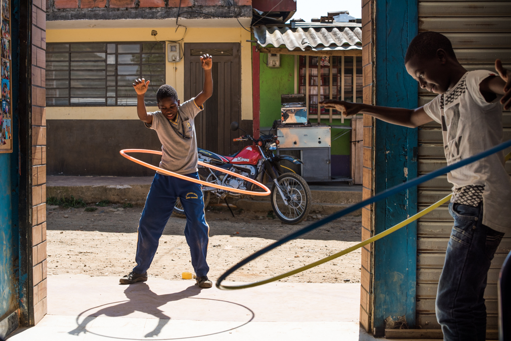 Children play at a community center in Bello