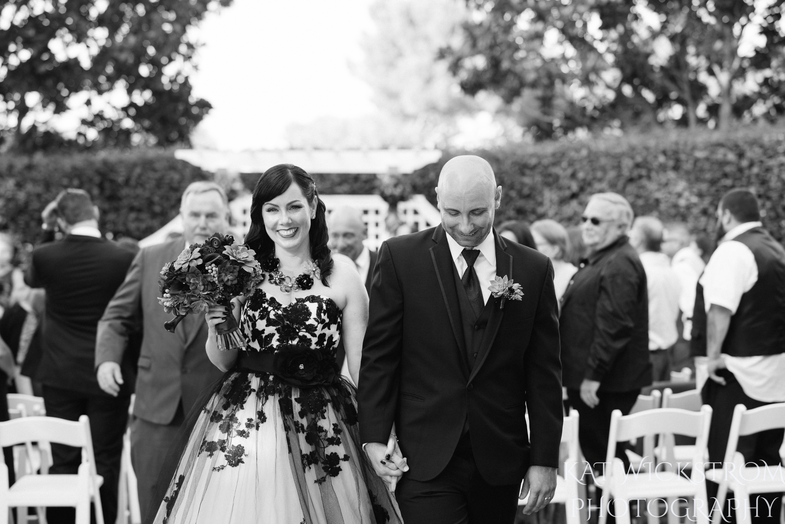 bride and groom walk away as husband and wife
