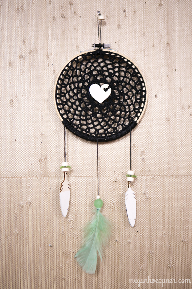 I made this dream catcher by inserting a doily into an embroider hoop. I then stitched the wood veneer heart to the center and strung the feathers. All supplies from Michaels (except the beads, which I had on hand).