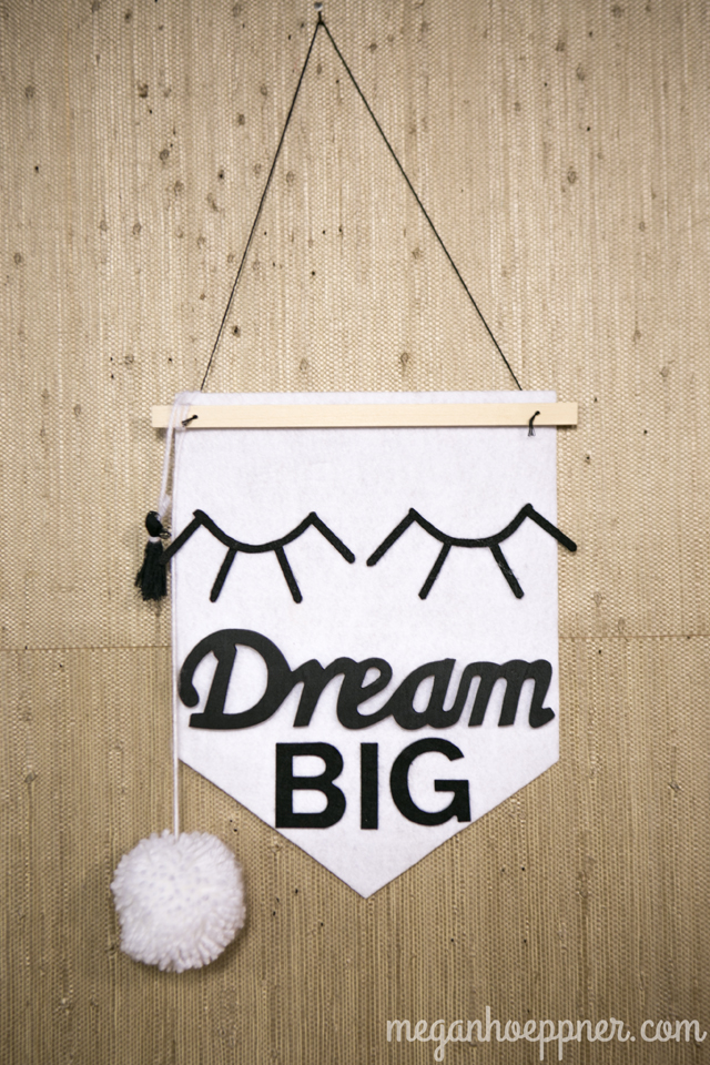 """I made this shield using stiff felt sheets and felt letter stickers, all purchased at Michaels. The """"Dream"""" is a wood piece that I spray painted black. It, too, is from Michaels."""