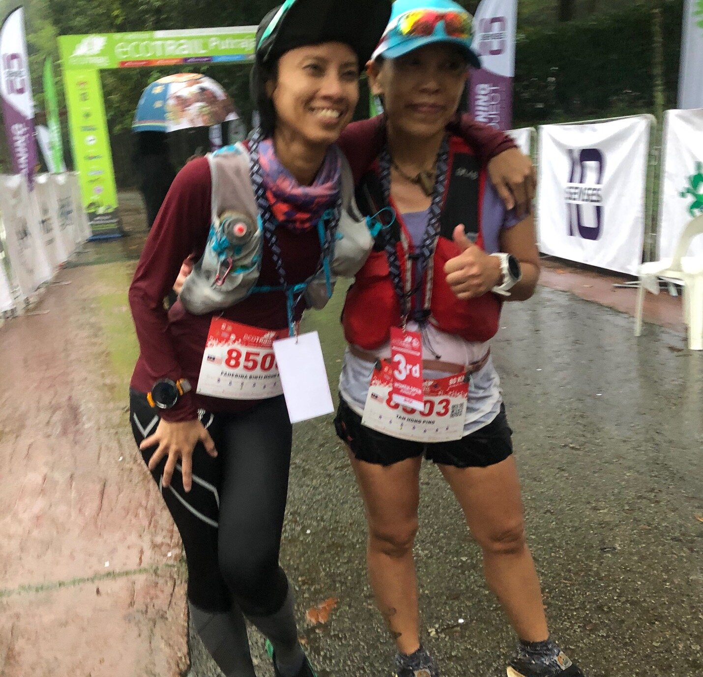 Faherina Mohd Esa and Renee Tan enjoyed their joint-run in the pouring rain at the end