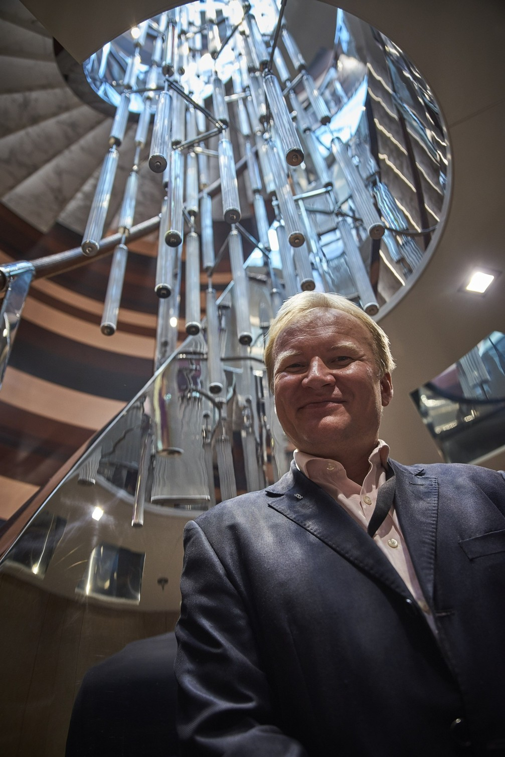 Mr. Marek Landa with 'Luminescent' 8m high staircase chandelier on board of MY Nerissa at Monaco Yacht Show 2017 Ⓒ  Crystal Caviar