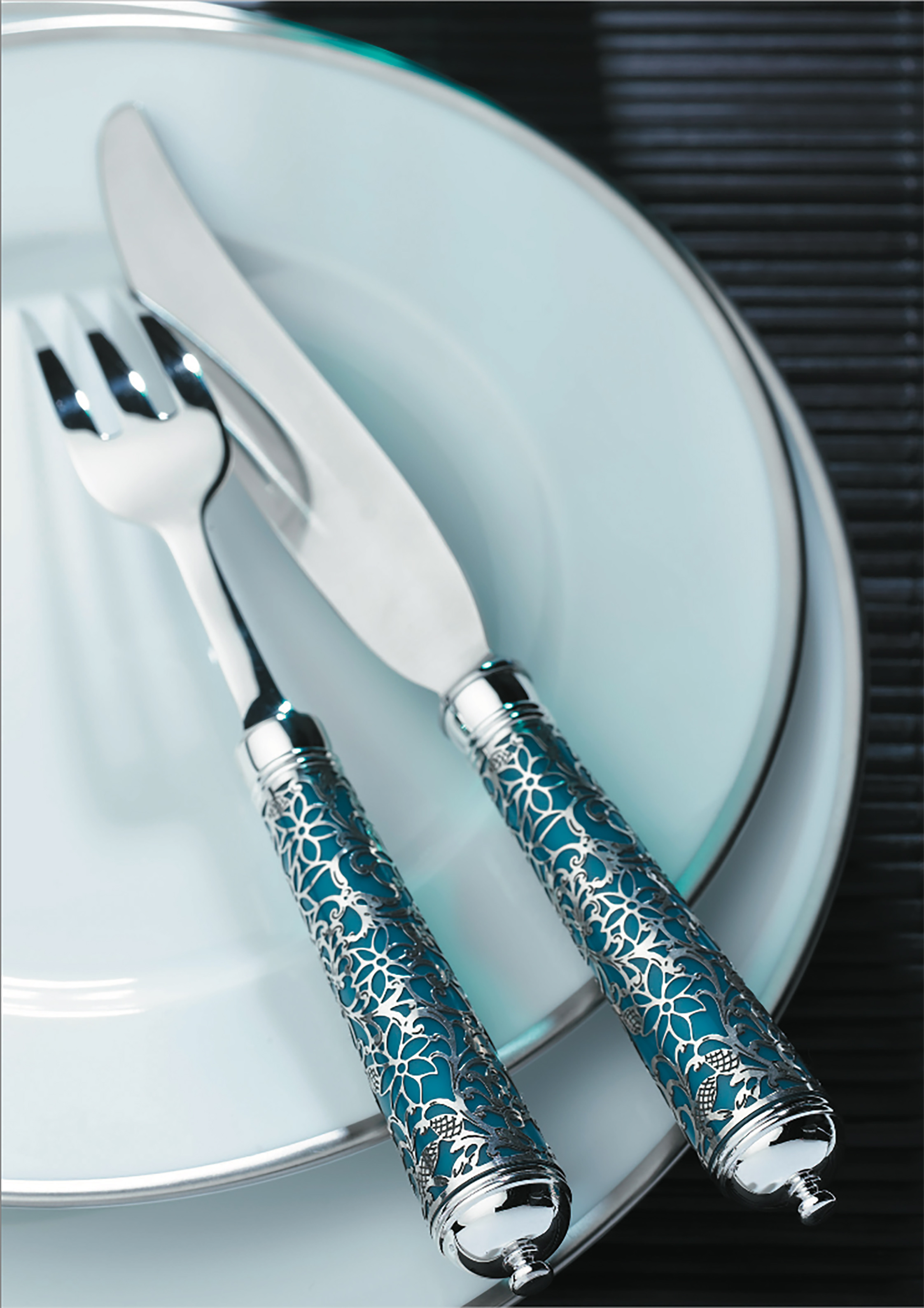 'Insolent' sterling silver cutlery with brightly coloured handles covered in a silver grid of intricate arabesques; Inspired by the Italian Renaissance Ⓒ  Ercuis