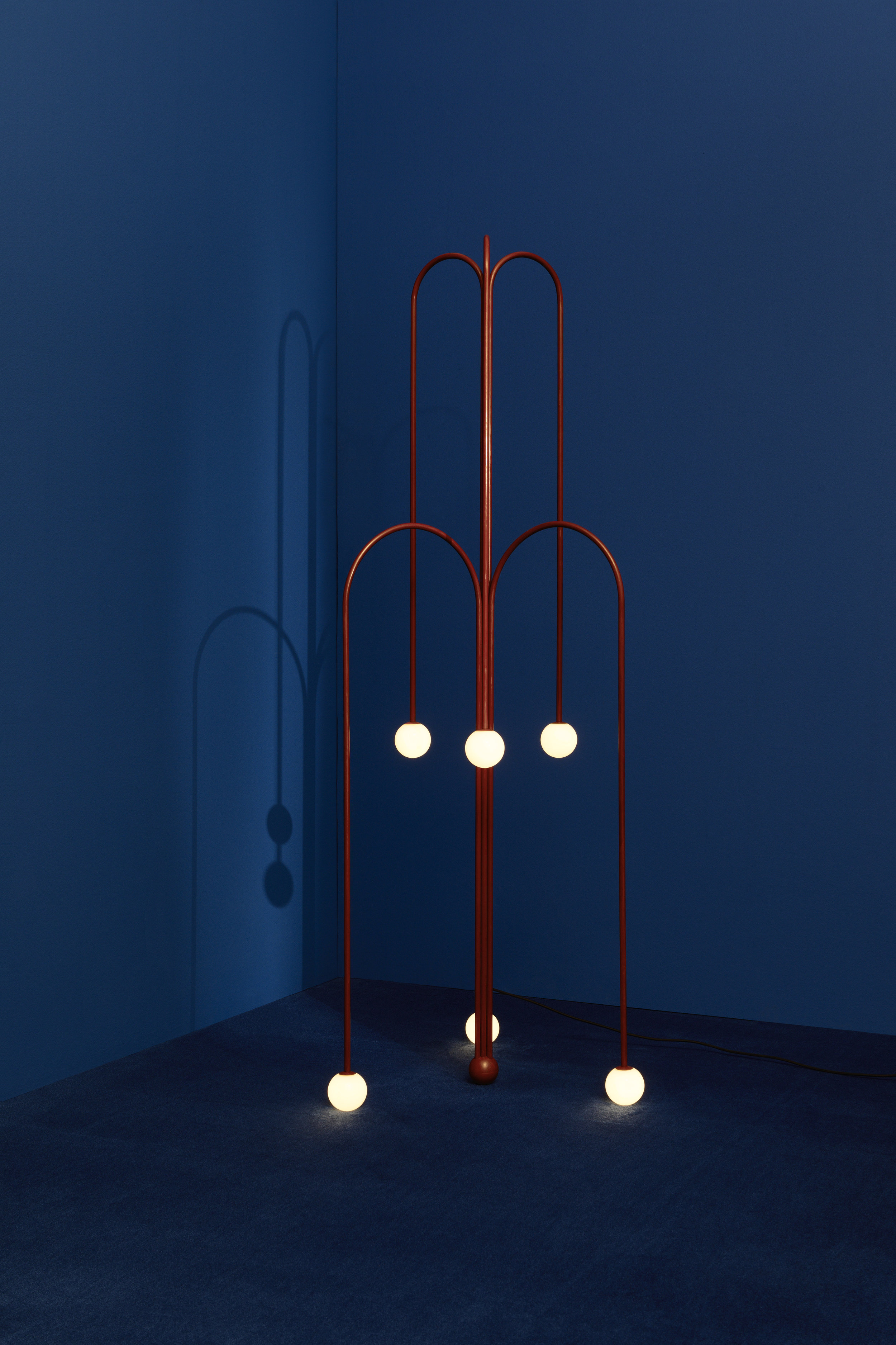 """Two """"Crossette"""" floor lamps – Fontana Amorosa collection, UK, 2017, on display at Nilufar stand, Design Miam/ Basel 2018  Design: Michael Anastassiades 6 lights, Nilufar limited edition of 45 examples + 2 APs CE certificate provided Red patina brass, mouth blown opaline spheres Black braided flex, inline dimmer; size: diam 72 x h 180 cm 