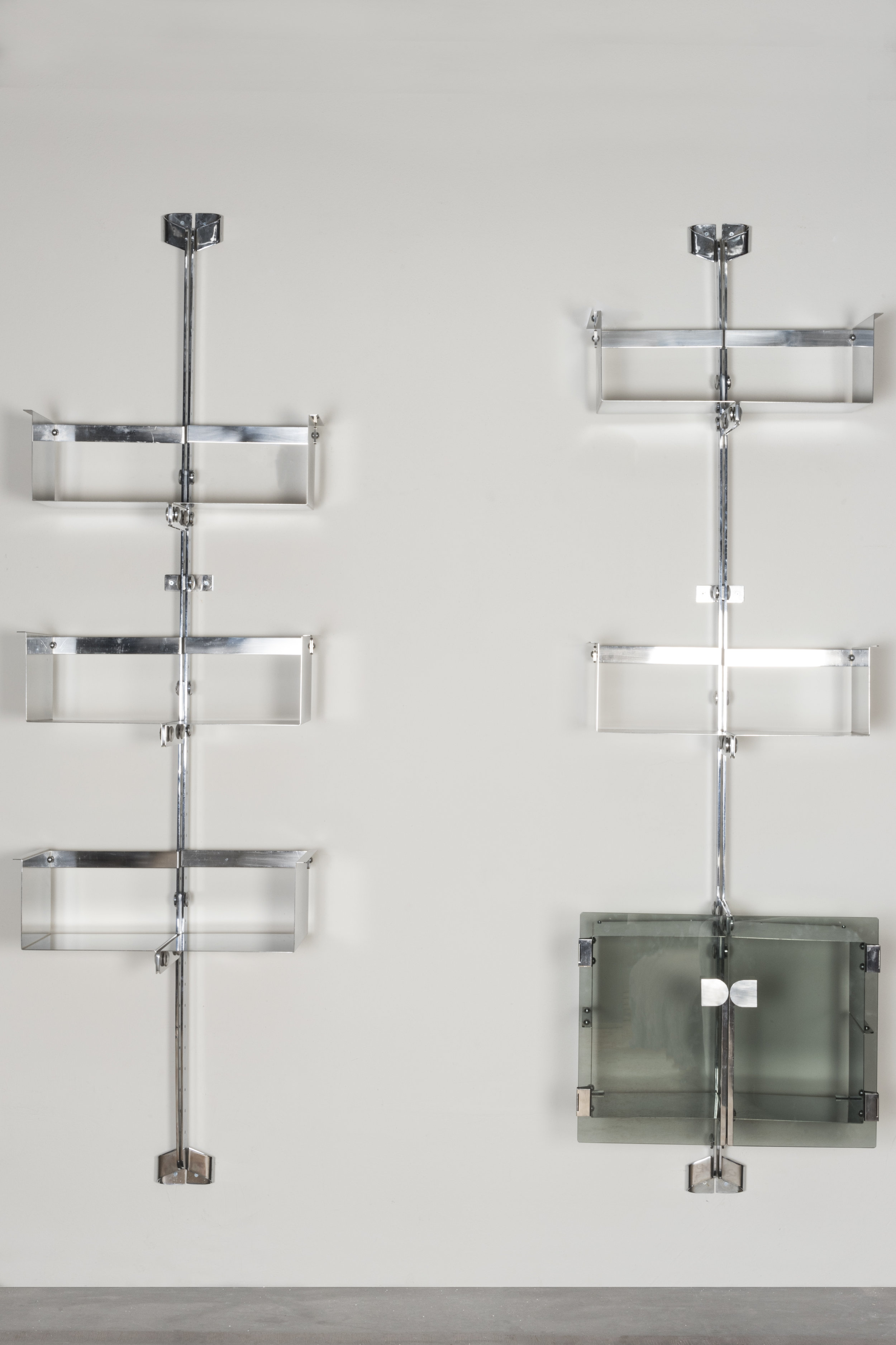 Three  Proposal  bookcases Italy, 1969, on display at Nilufar stand, Design Miami 2018  Design: Vittorio Introini Manufactured by Saporiti  Chromed steel, glass; Single module size: 65x37xh232cm / 25.5x14.5xh 91.3 in
