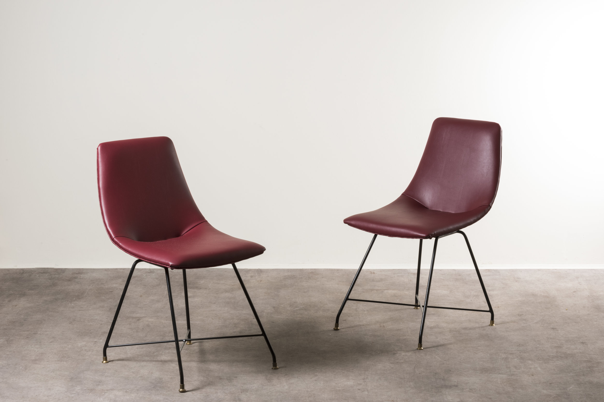 Chairs, Italy, 1950s  Design: Augusto Bozzi Manufactured by Saporiti Painted steel, leather upholstery Size: 44 x 49 x h 80 | seat h 44 cm / 17,3 x 19,2 x h 31,4 | h seat h 17,3 in  ⓒ Nilufar Gallery