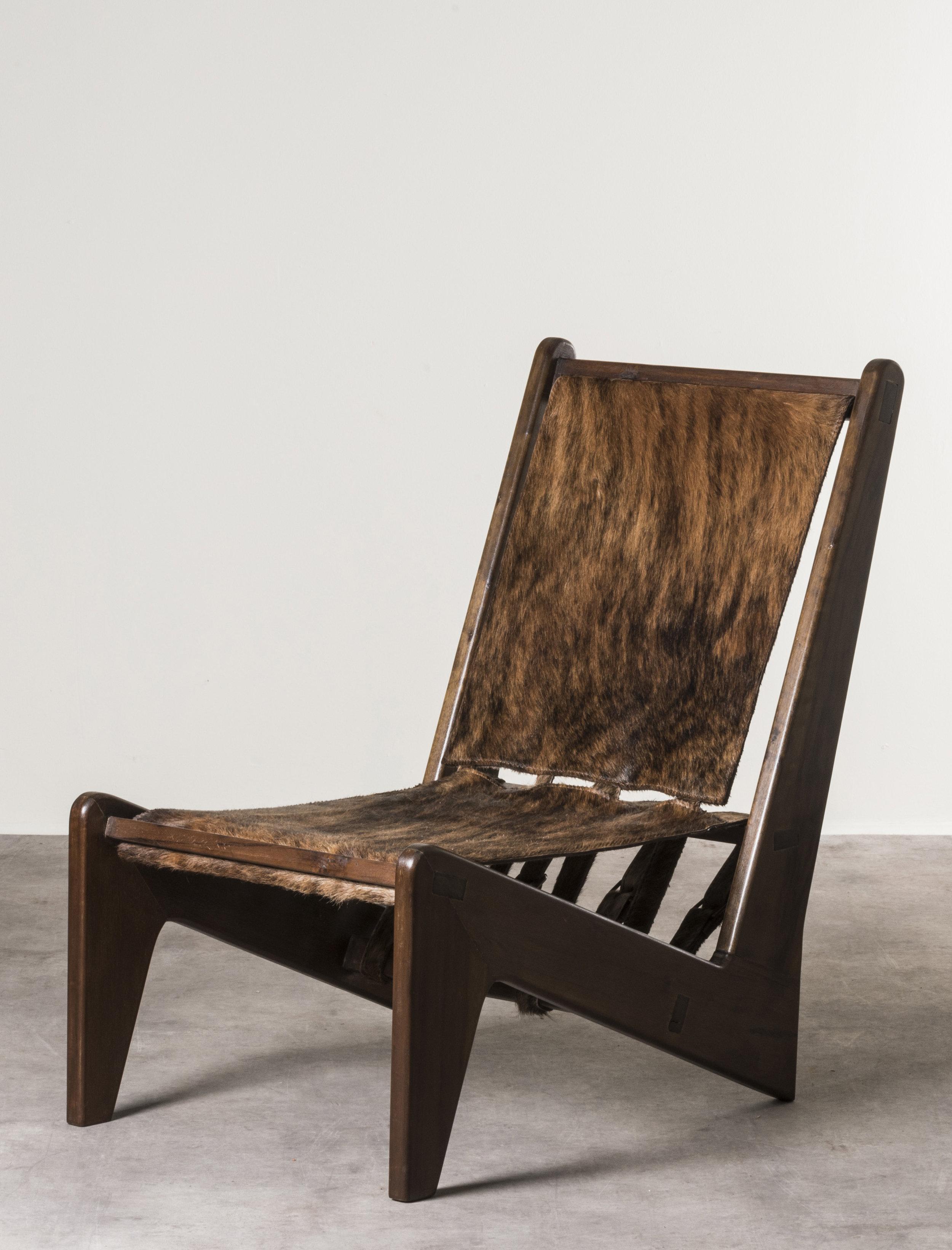 Zig Zag  armchairs, Brazil 1949 - 50, on display at Nilufar stand, Design Miami 2018  Design: Giancarlo Palanti Manufactured by Estúdio de Arte palma, LBB and Palanti, Sāo Paulo Cabreuva wood, Cavallino leather upholstery Size: 55,4 x 90 x h 81,5 cm / 21,8 x 35,4 x h 32,1 in  ⓒ Nilufar Gallery
