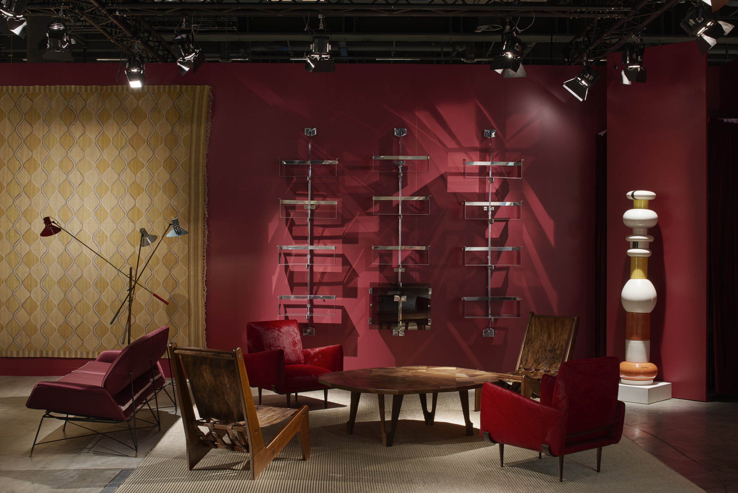 Nilufar stand at Design Miami/ Basel 2018 - on display Jorje Zalszupin's red cavalino armchairs,  Zig Zag  lounge chairs by Estúdio de Arte Palma: LBB and Palanti and off‐cut low table designed by Martino Gamper