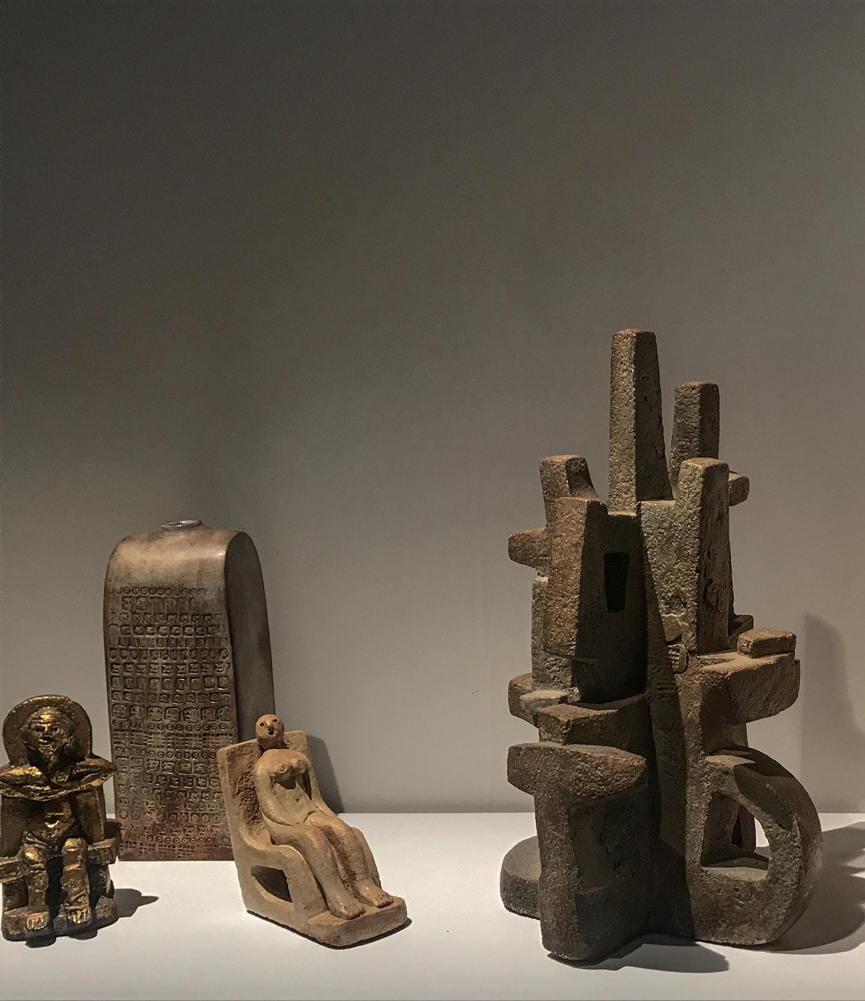 Lebreton Gallery - Design Miami/Basel 2018  Left to right: 'Personnage sur un Trône' - ceramic, 18 cm, 'Vase Empreintes' in glazed ceramic (31 cm) 'Personnage dans un Fauteuil' - ceramic (15.5 cm), and Cactus (47 cm) ca. 1970 by Eugene Fidler