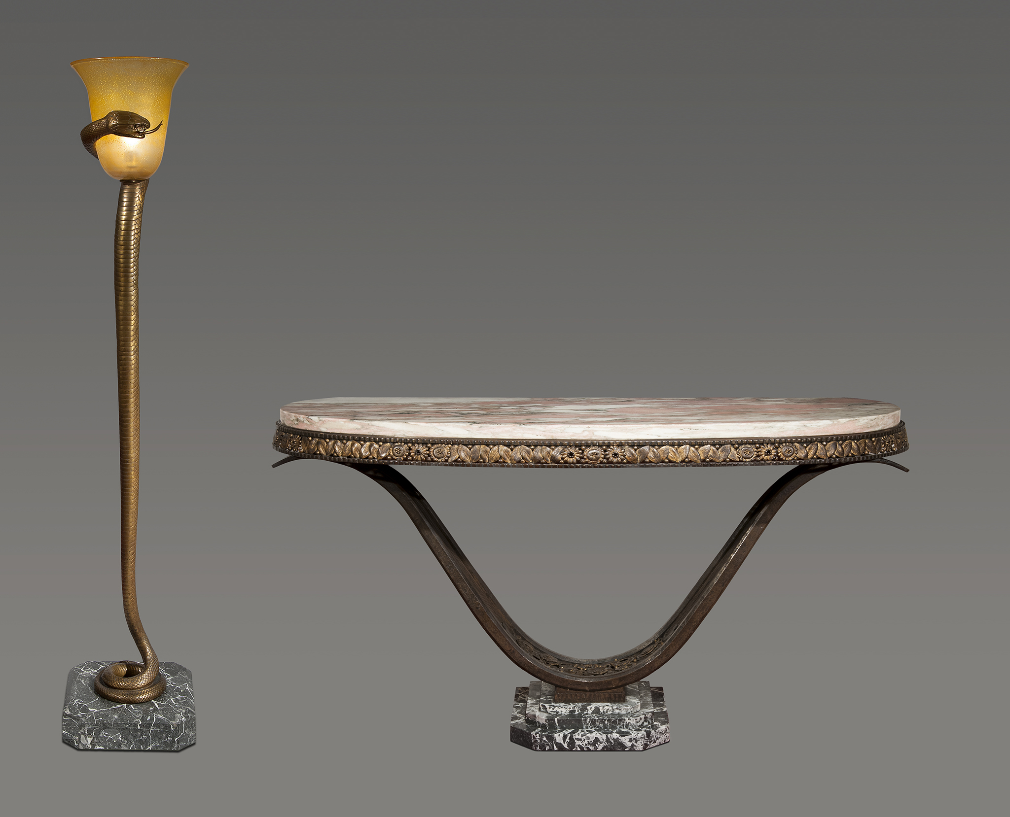 Antique console in patinated wrought iron, steel and marbre and 'La Tentation' bronze and glass floor lamp by Edgar Brandt 1925 Courtesy of Robert Zehil Gallery